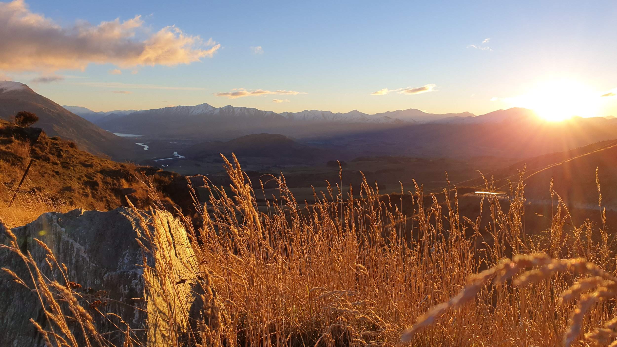 The golden sun rays over the peaks