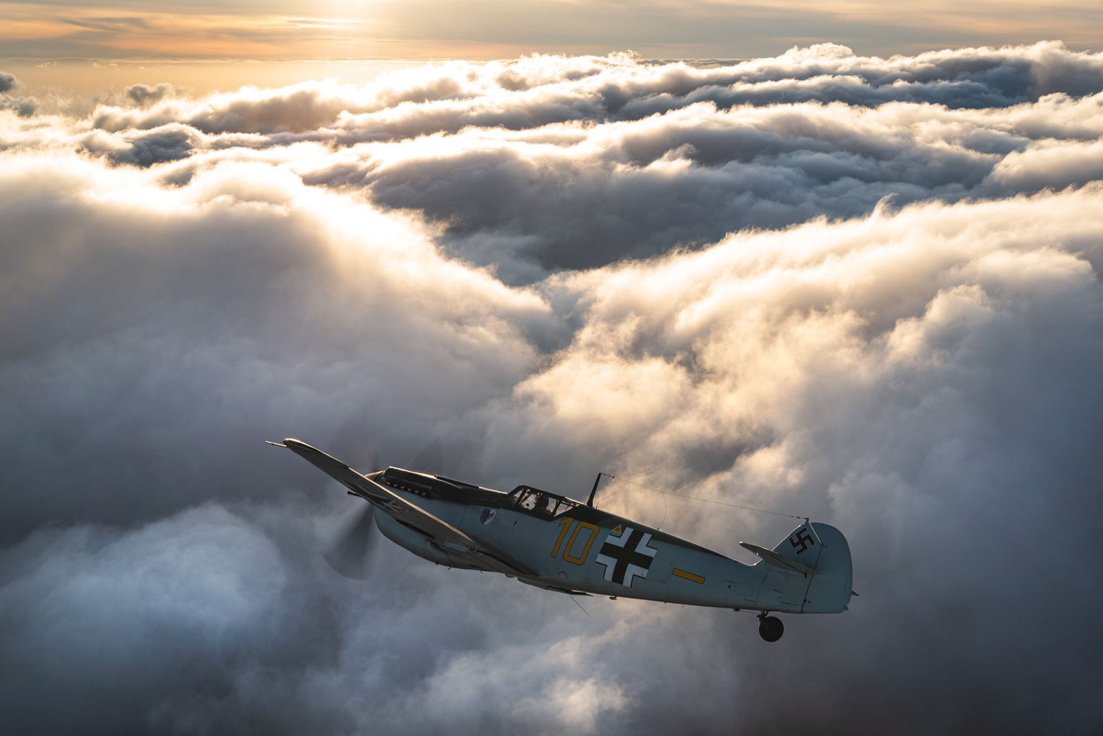 ARCo-109-Buchon-flying-above-the-clouds.jpg