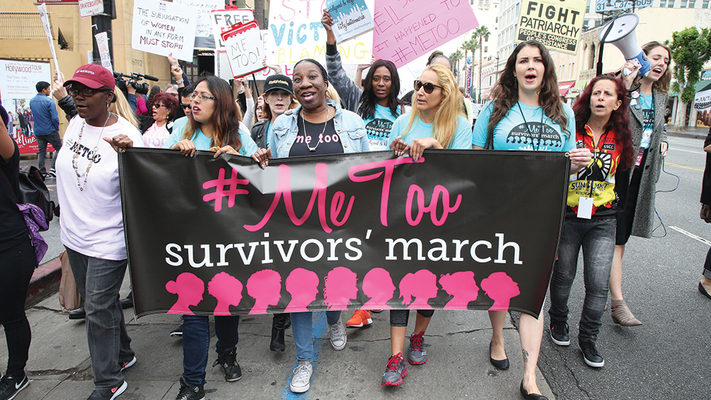 Protesters at the #MeToo survivors' march : thousands march in LA as sexual misconduct allegations continue