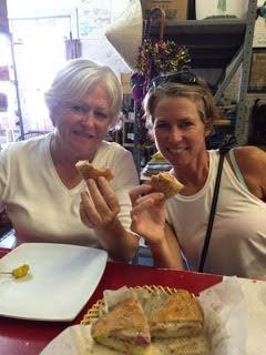 Bonnie (left) and her daughter, enjoying their muffaletta