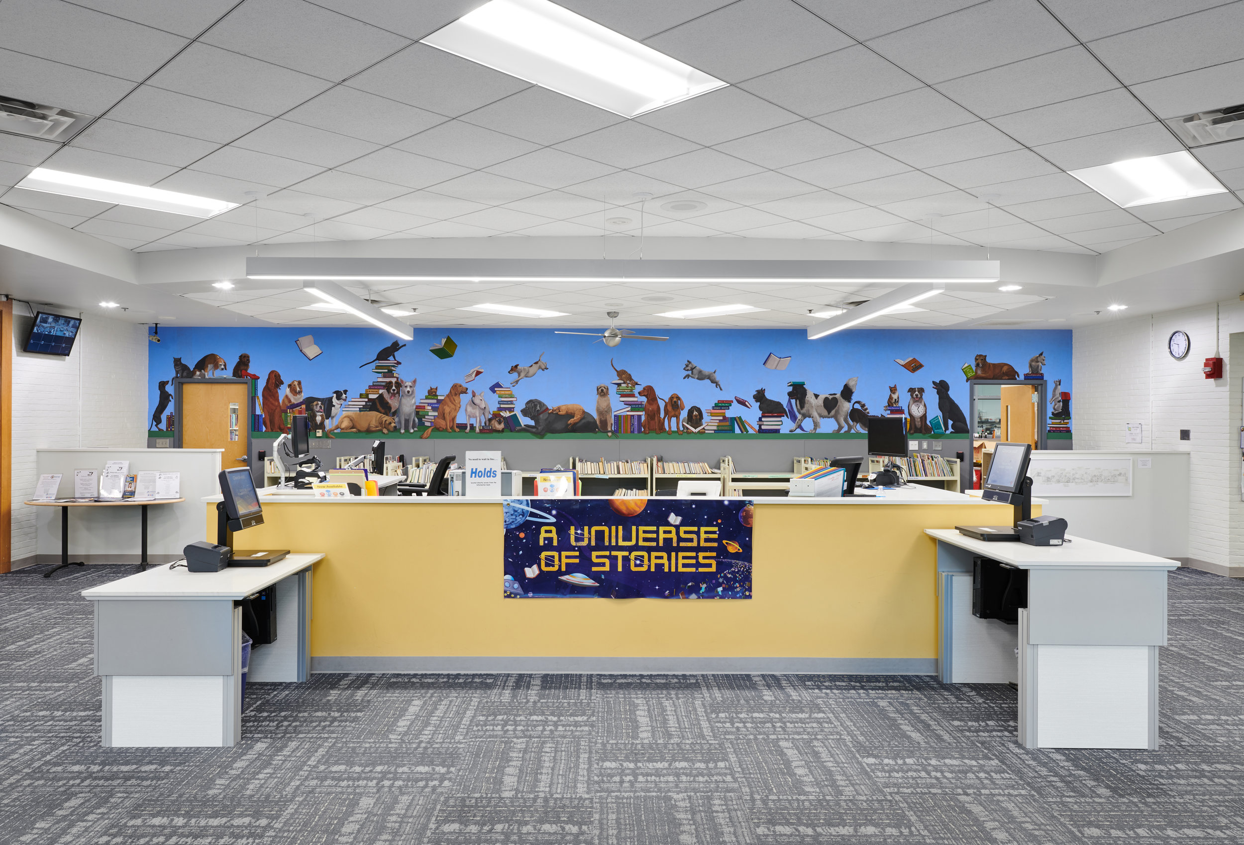 """Connie Morella Library Bethesda, Maryland """"Literary Dogs and a Few Cats""""  40' w x 5' h  View from the front of the circulation desk"""