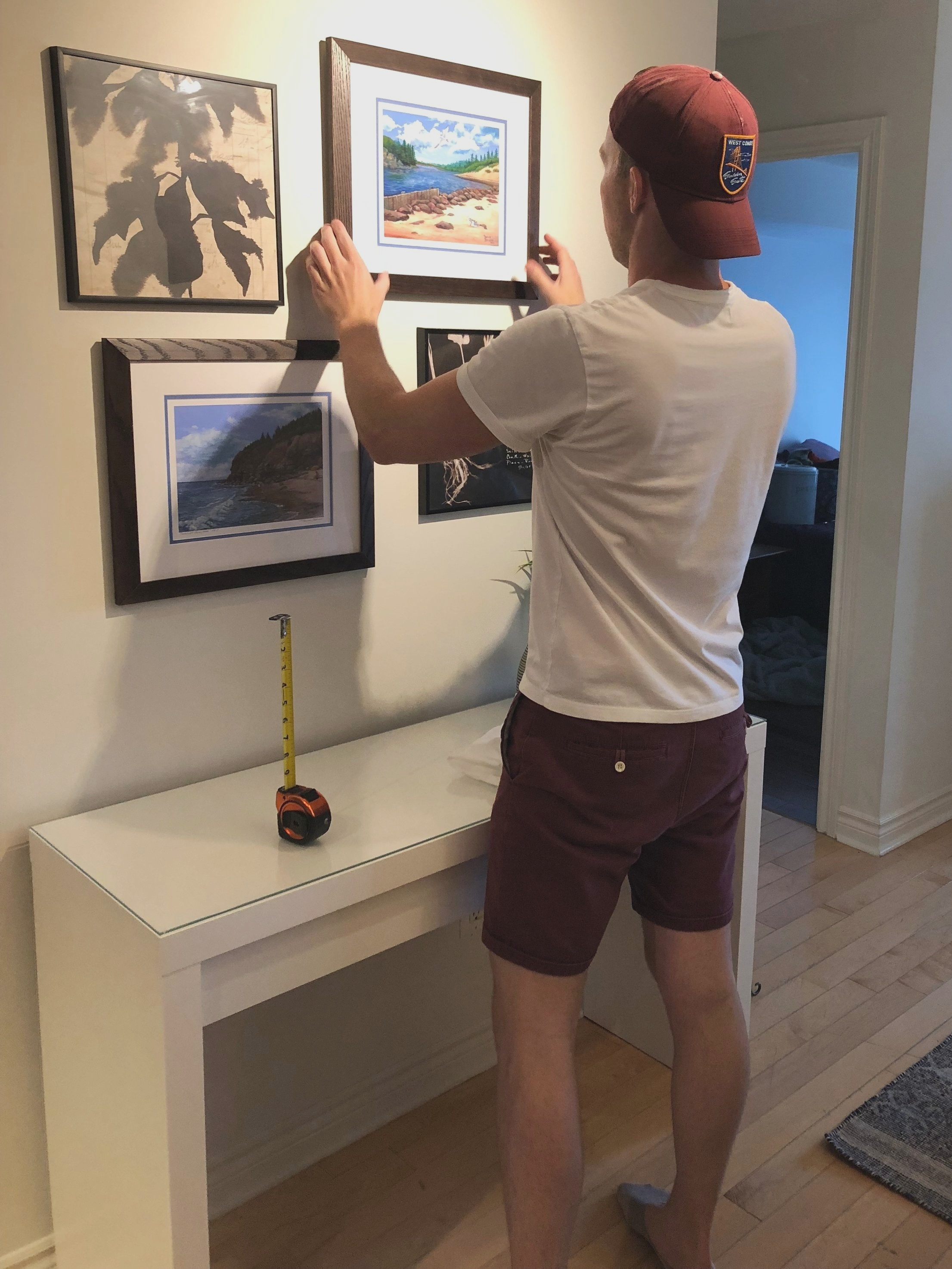 Hanging a gallery wall over the new desk area. This is going to be the perfect spot for the contest winners to work from home.