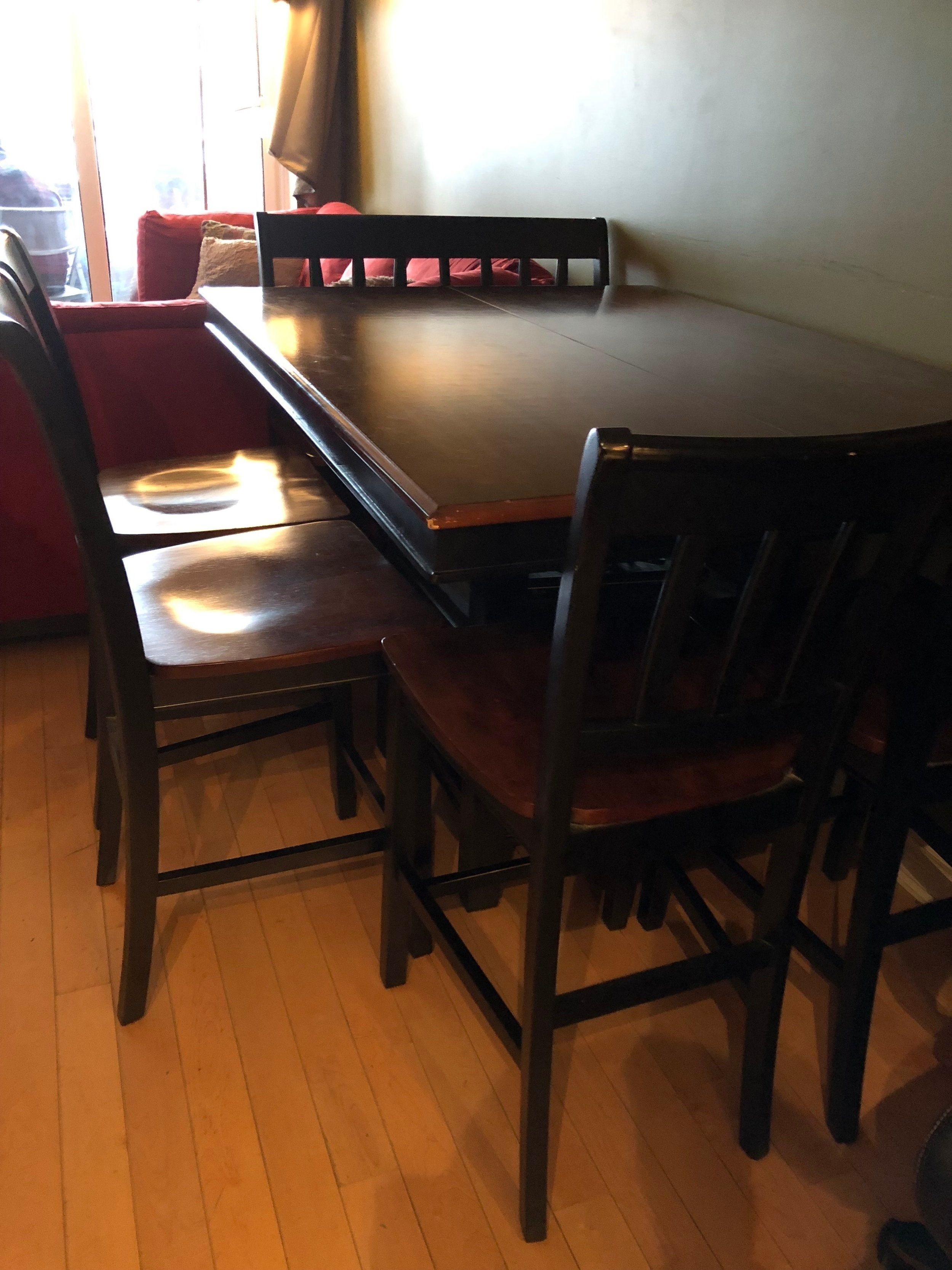 "The old dining area was located off the living room. There was room for six dining chairs but most of the time the homeowners only used two. ""Our space feels cramped with oversized furniture,"" said the contest winners in their contest submission. ""We have a large counter-height dining table that seats 6-8, but we didn't account for how small it makes our space feel."""