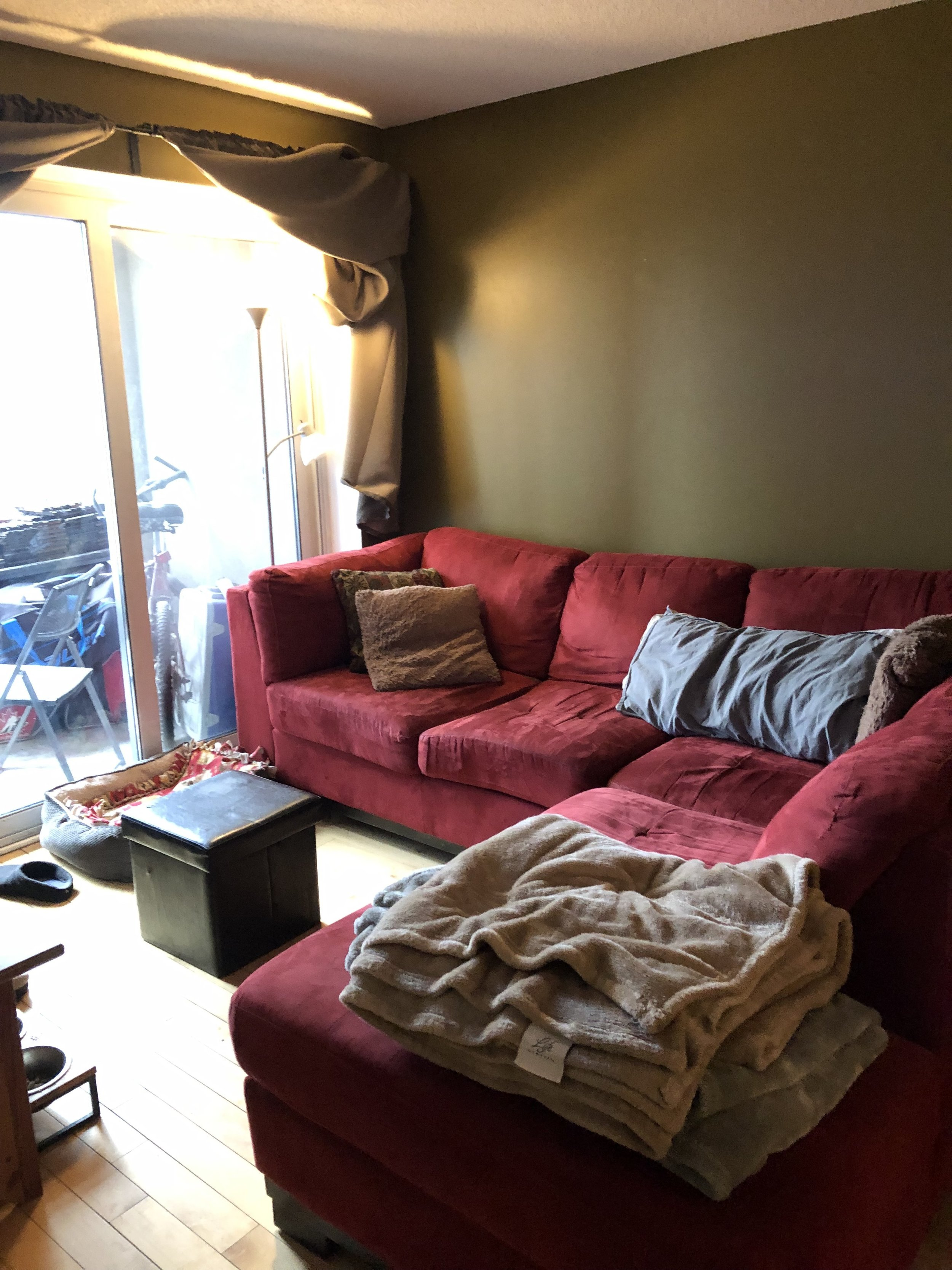 "It was hard to miss the large red sofa as soon as you walked in to this condo. ""Our living room lacks cohesion and it's not pleasing to the eye"","" said one of the contest winners. ""I believe we took the 'What's the most affordable?' approach when it came to buying furniture."""