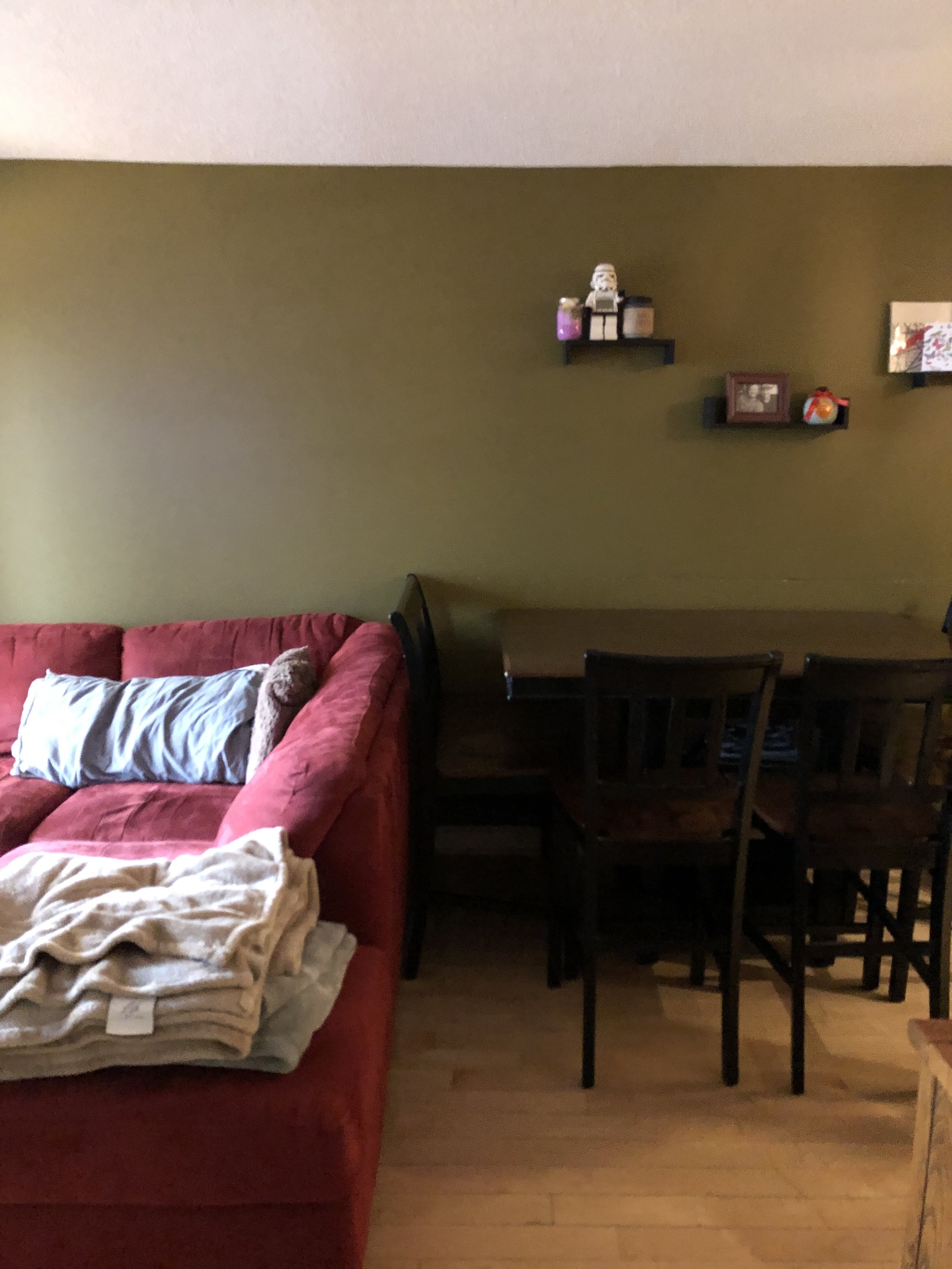"The old living room had green walls, an oversized red sofa and a large dining table. ""The colour of our walls are dark which makes the condo feel sad and unwelcoming,"" said the contest winners."