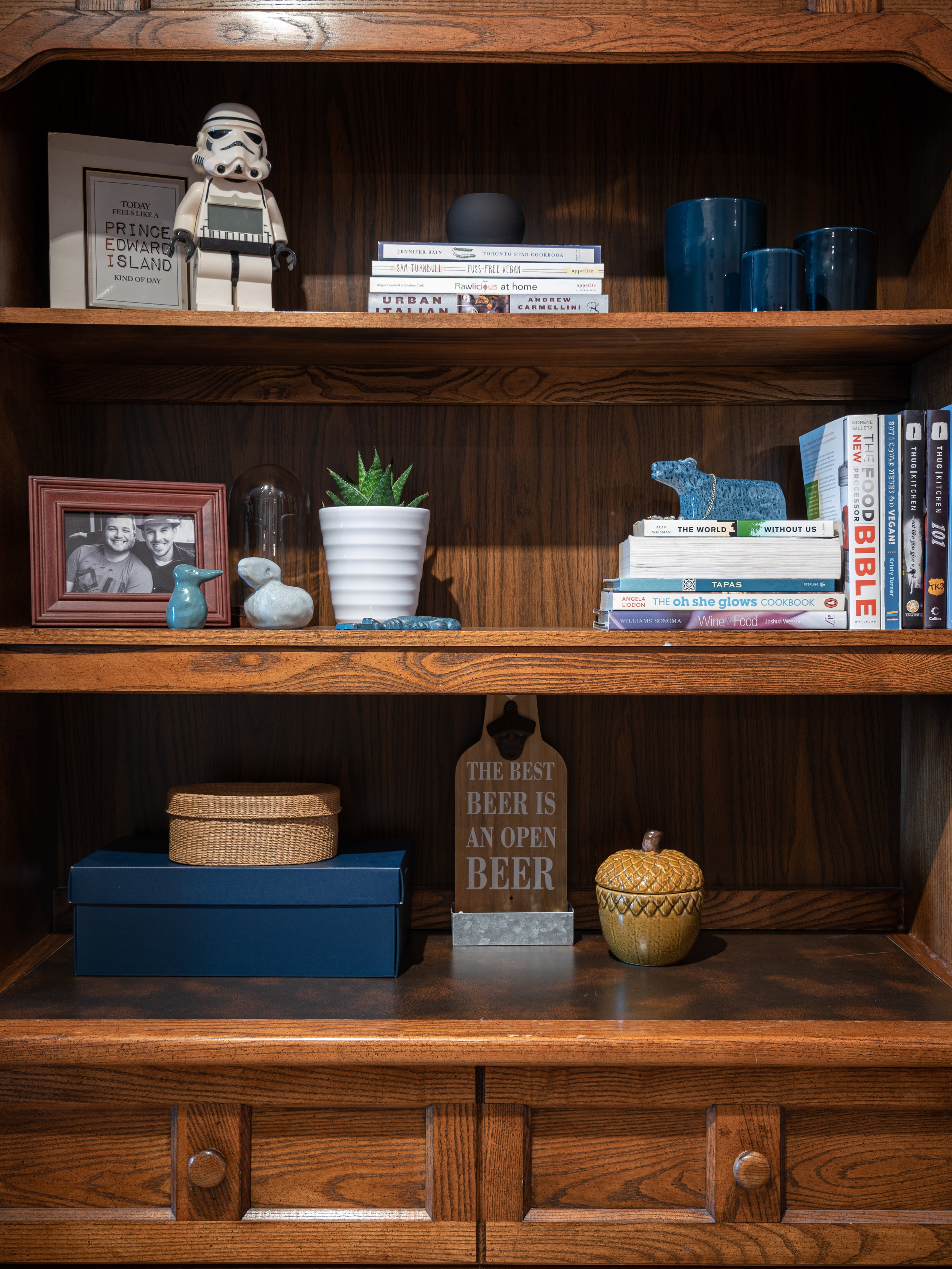 Simple re-styling at its best! Cookbooks and tchotchkes are now artfully arranged on the hutch and during dinner parties this is a great bar area.