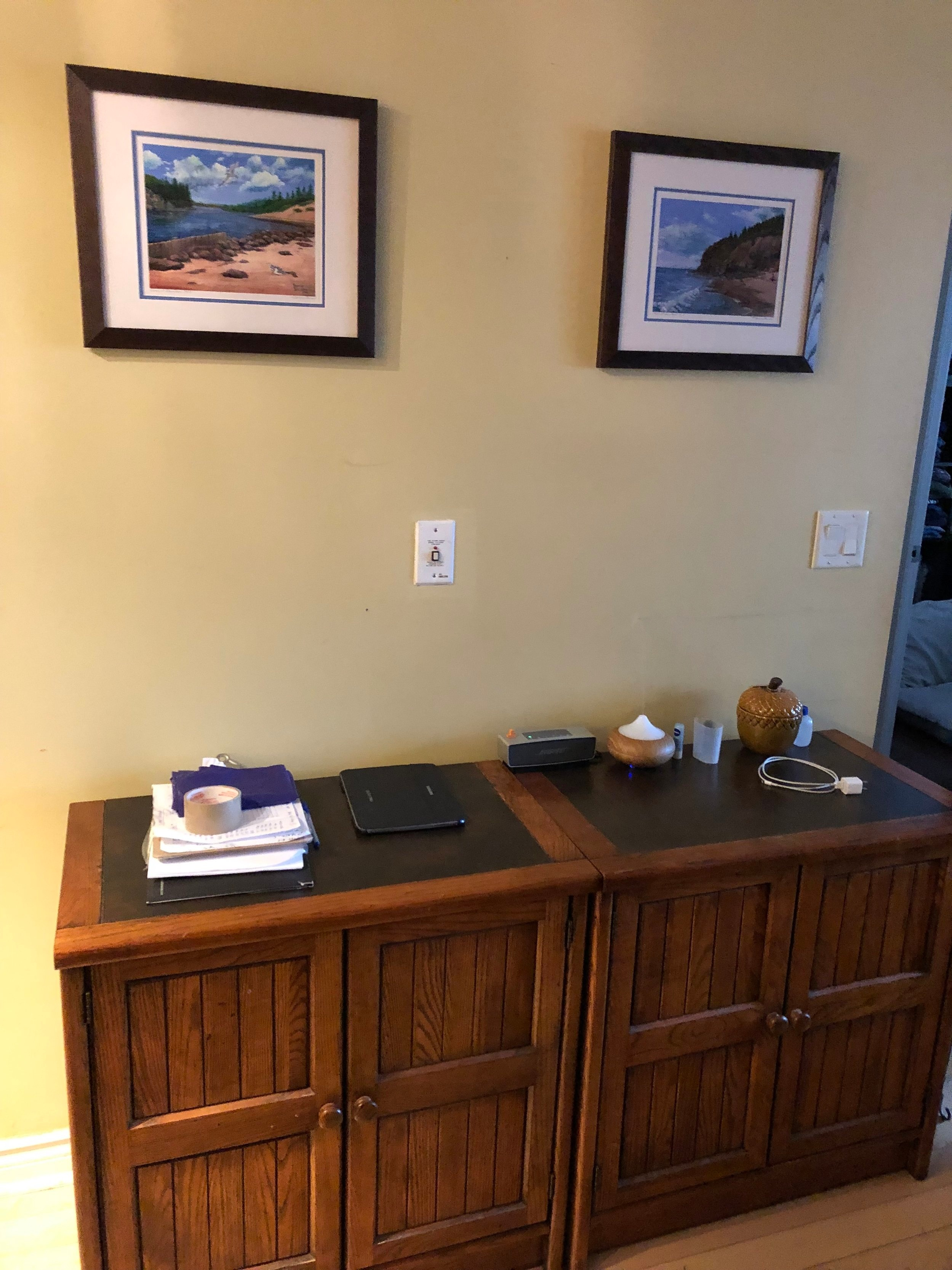 A pair of chunky wooden cabinets made this pass-through zone between the dining and living areas feel dated. Although these cabinets had lots of storage space, having a desk area to work from home was more important to the homeowners.