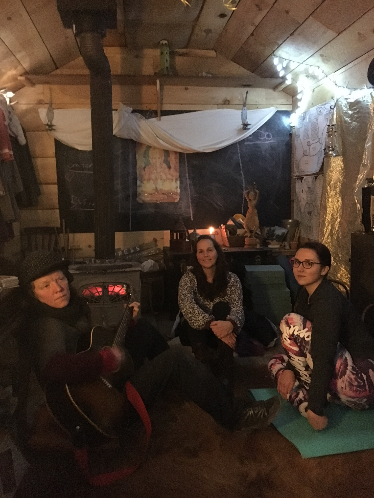 Maze giving my mother and I a concert in the cabin on the Camp Now Art Farm.