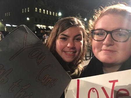 Me and my roommate Claire pose at an anti-Trump rally in Grand Rapids, MI, following the 2016 election [Ayla Hull].