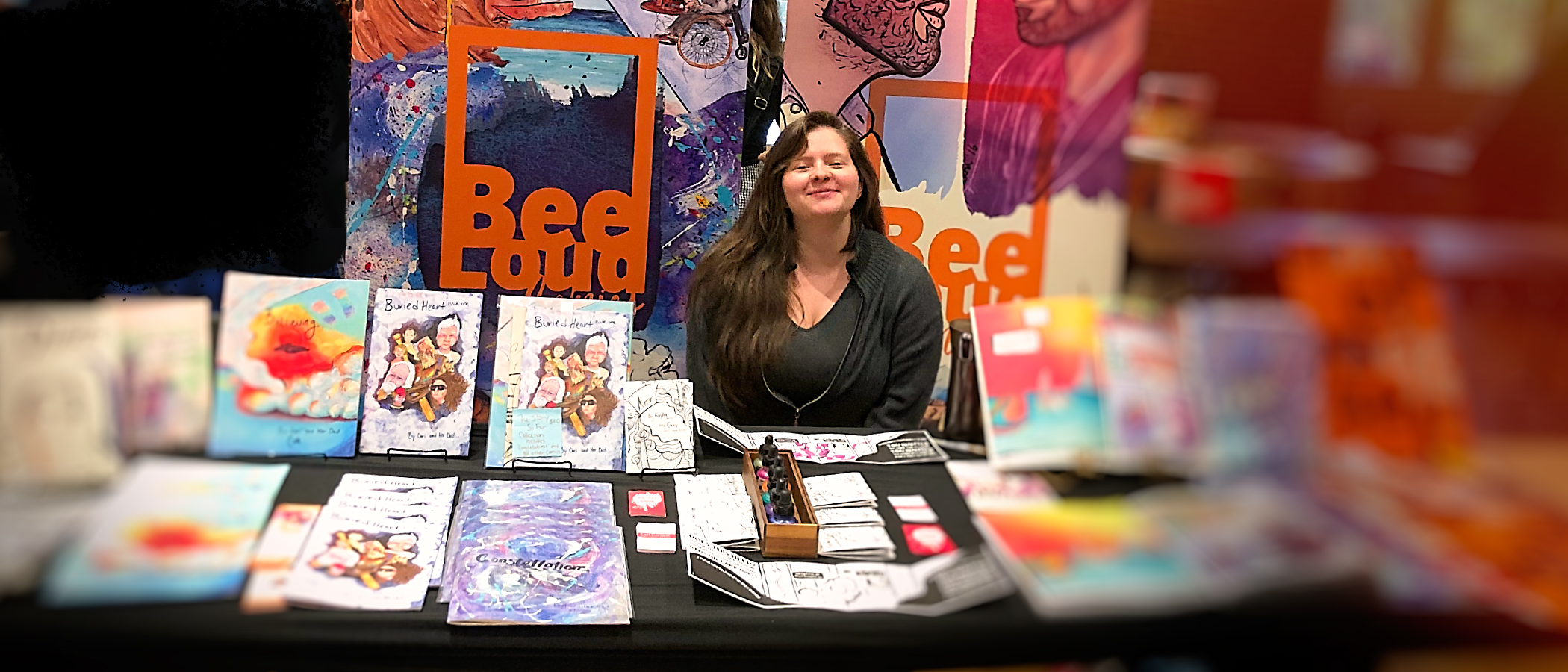 Me (Cari) tabling at the Zine Machine Fest in Durham, NC, with my and my students' work, 2018. My students often table alongside me, so imagine a few young cartoonists around me here : )