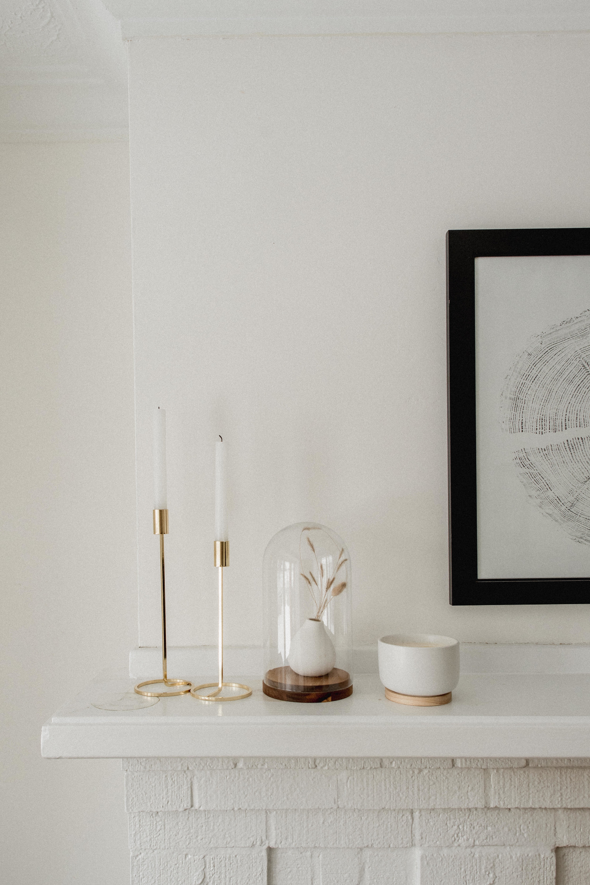 Simple minimalist mantle styling with candle holders