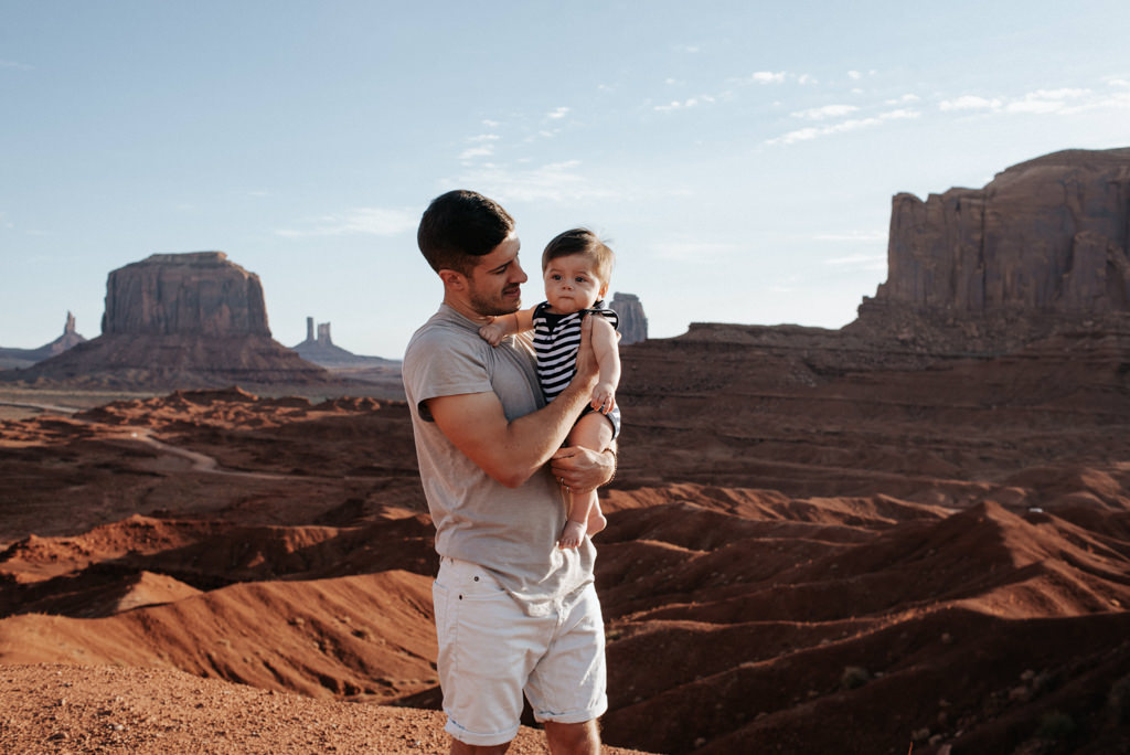 Young father with infant son at Monument Valley