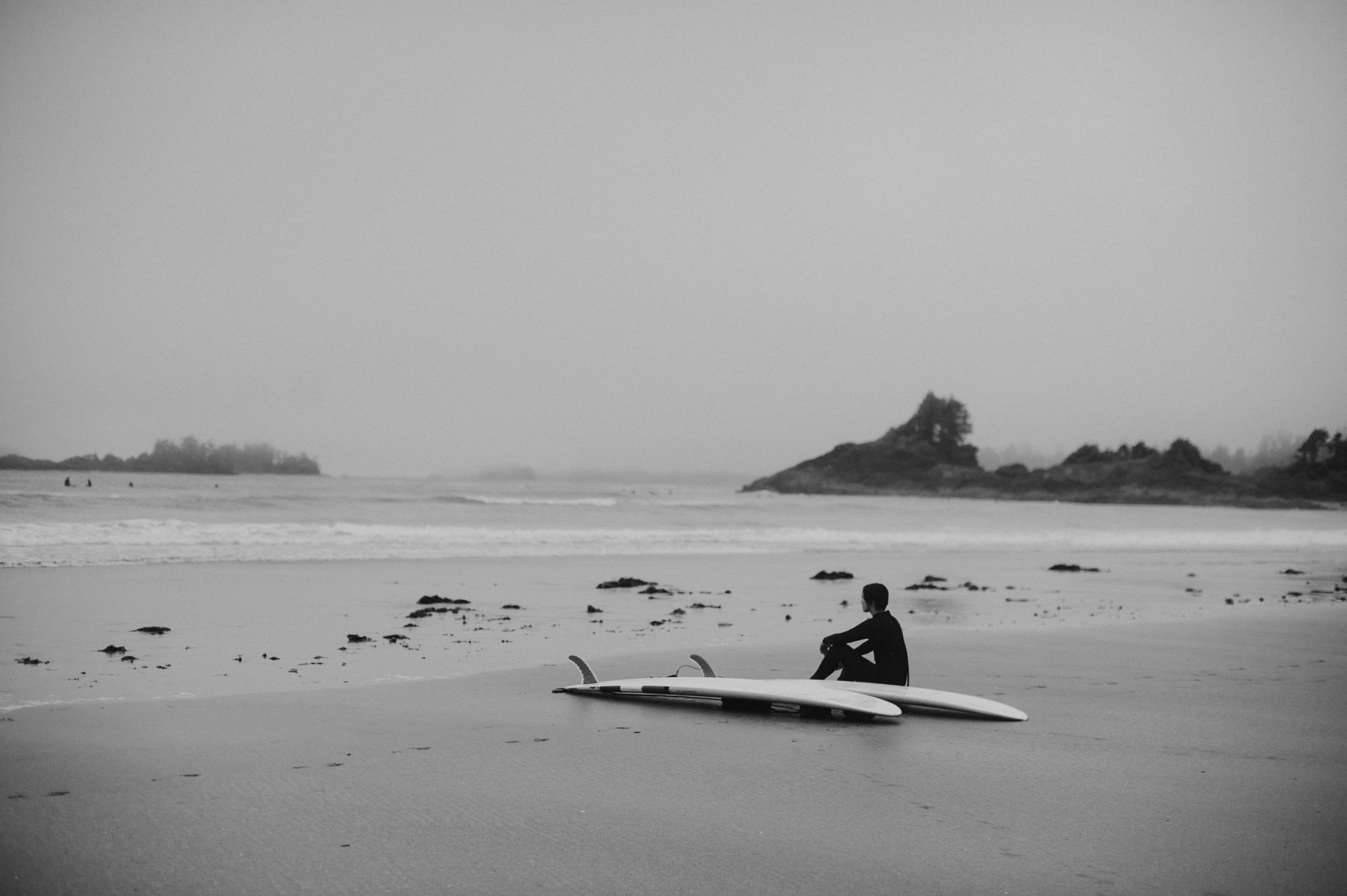 Surfer relaxing at Cox Bay in Tofino