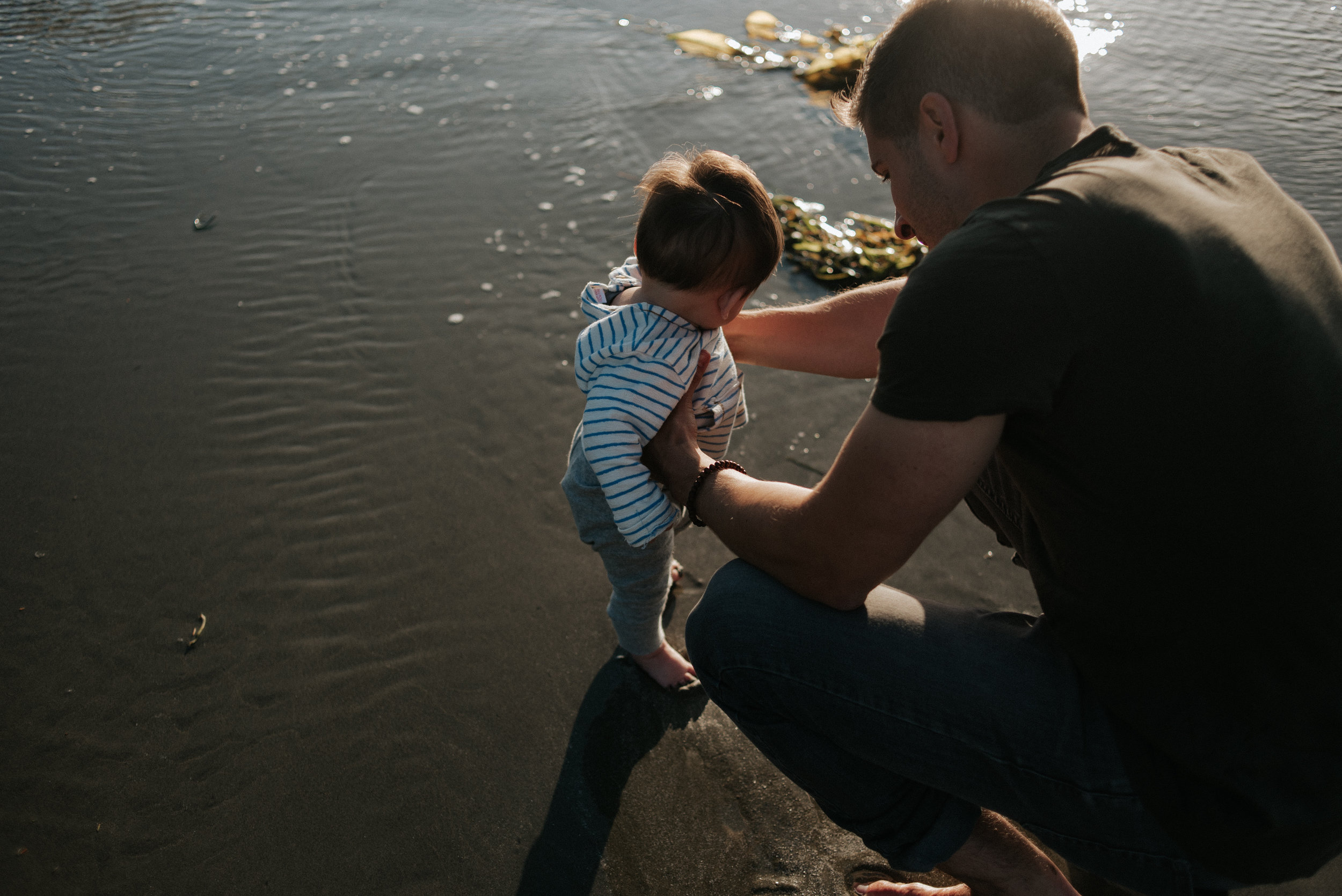 Young dad with son at Cox Bay in Tofino