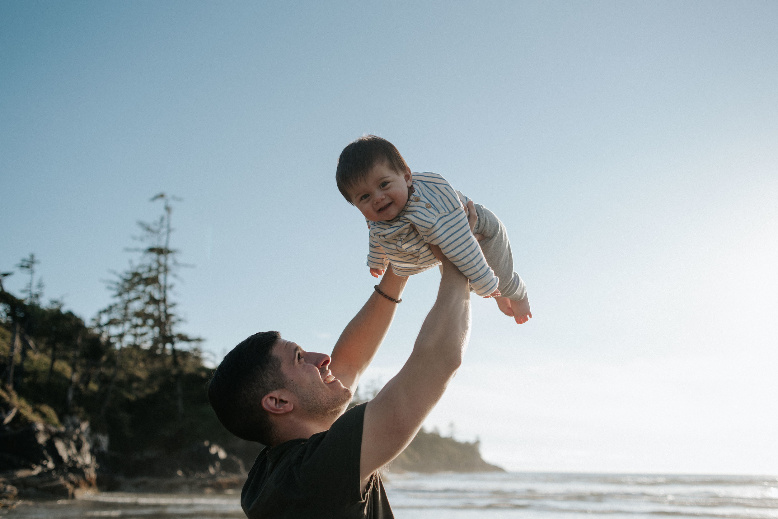 Young father with baby son at Cox Bay in Tofino