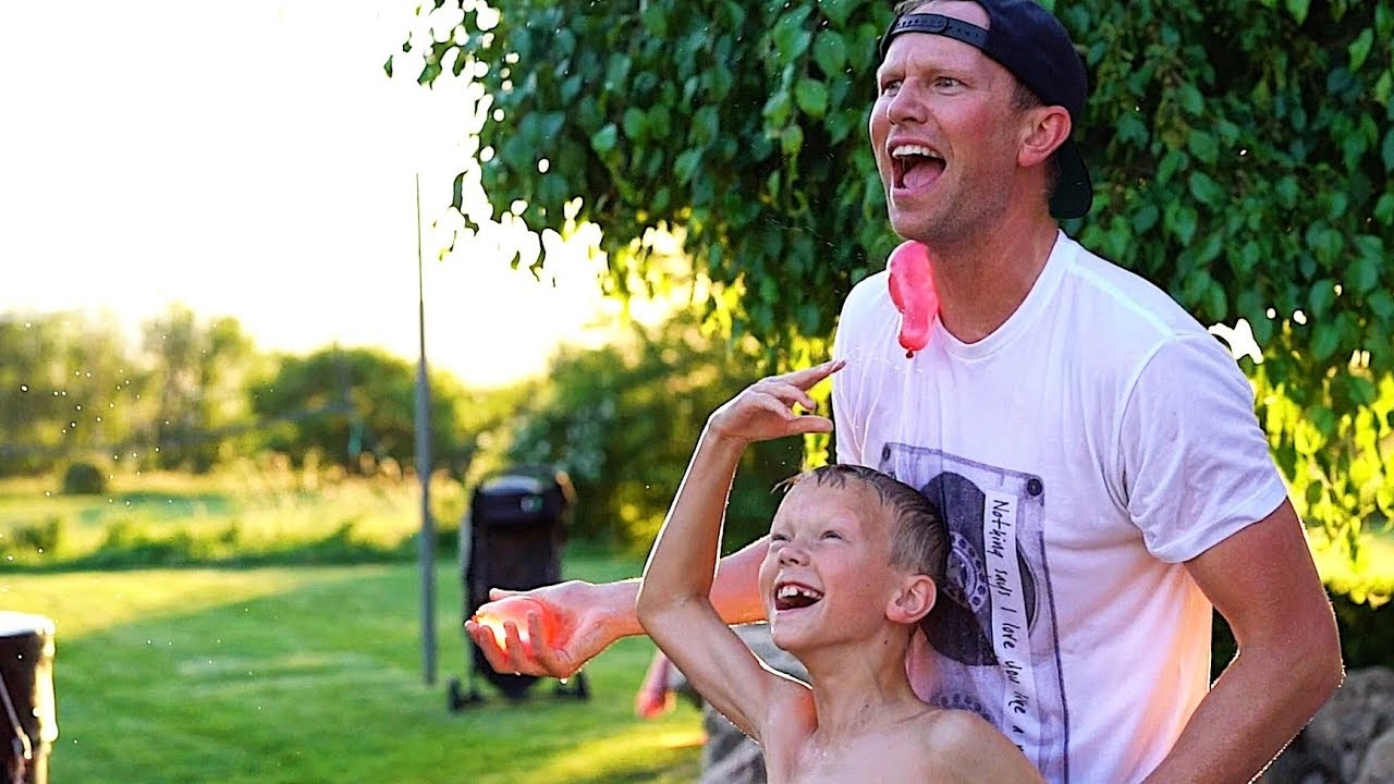 FATHER-SON WATER BALLOON WAR in SLO MO - CLICK HERE TO WATCH IT