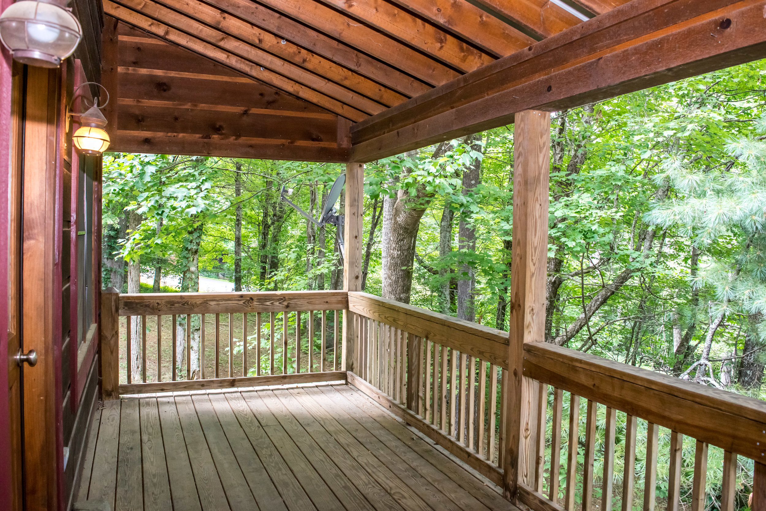 Beautiful open space for living room, dining area & kitchen plus large deck with great views!
