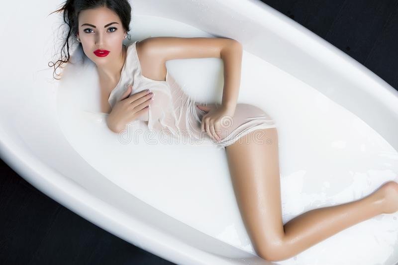 beautiful-young-brunette-woman-relaxing-milk-bath-rejuvenation-skin-pampering-treatment-beautiful-young-woman-relaxing-milk-102342716.jpg