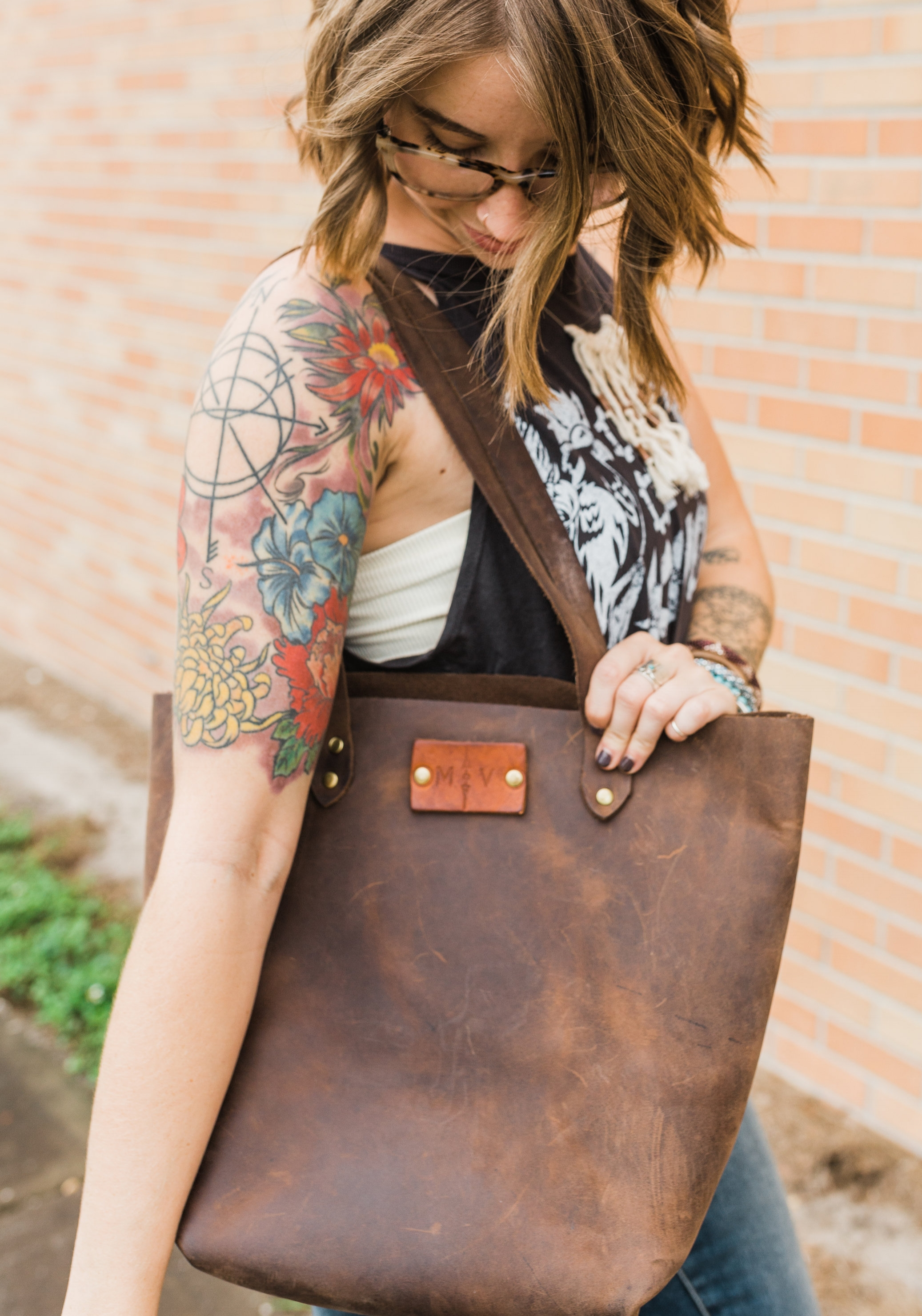 Margaret Vera - These leather goodies are all designed by Meg, herself! These hand crafted totes, wallets, and more are made from reclaimed leather. My bag is the grace tote and has started to wear in so well! Her products are timeless and made to last.Insta: @shopmargaretveraShop her amazing leather goods at https://margaretvera.com/collections/all!