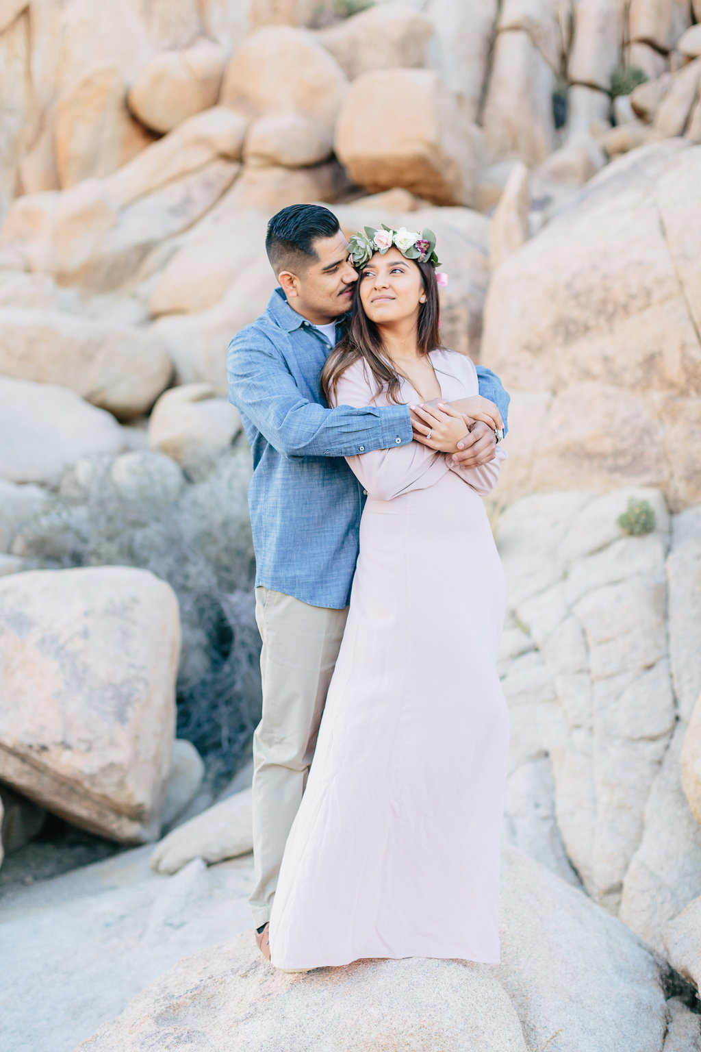 It was so special to spend a spring day with Briana and JR in Joshua Tree. Briana put so much thought in all her chic outfits from a gorgeous maxi dress with a floral crown to her laid back jean and a shirt! Plus there props all went with their Mexican inspired engagement session.  To this day, I am still wondering where she got that colorful zarape. The perfect combination to get us ready for the most amazing sunset photos!    I had such a wonderful time with them during their engagement session, and I am so excited to share a few of my favorites with you!