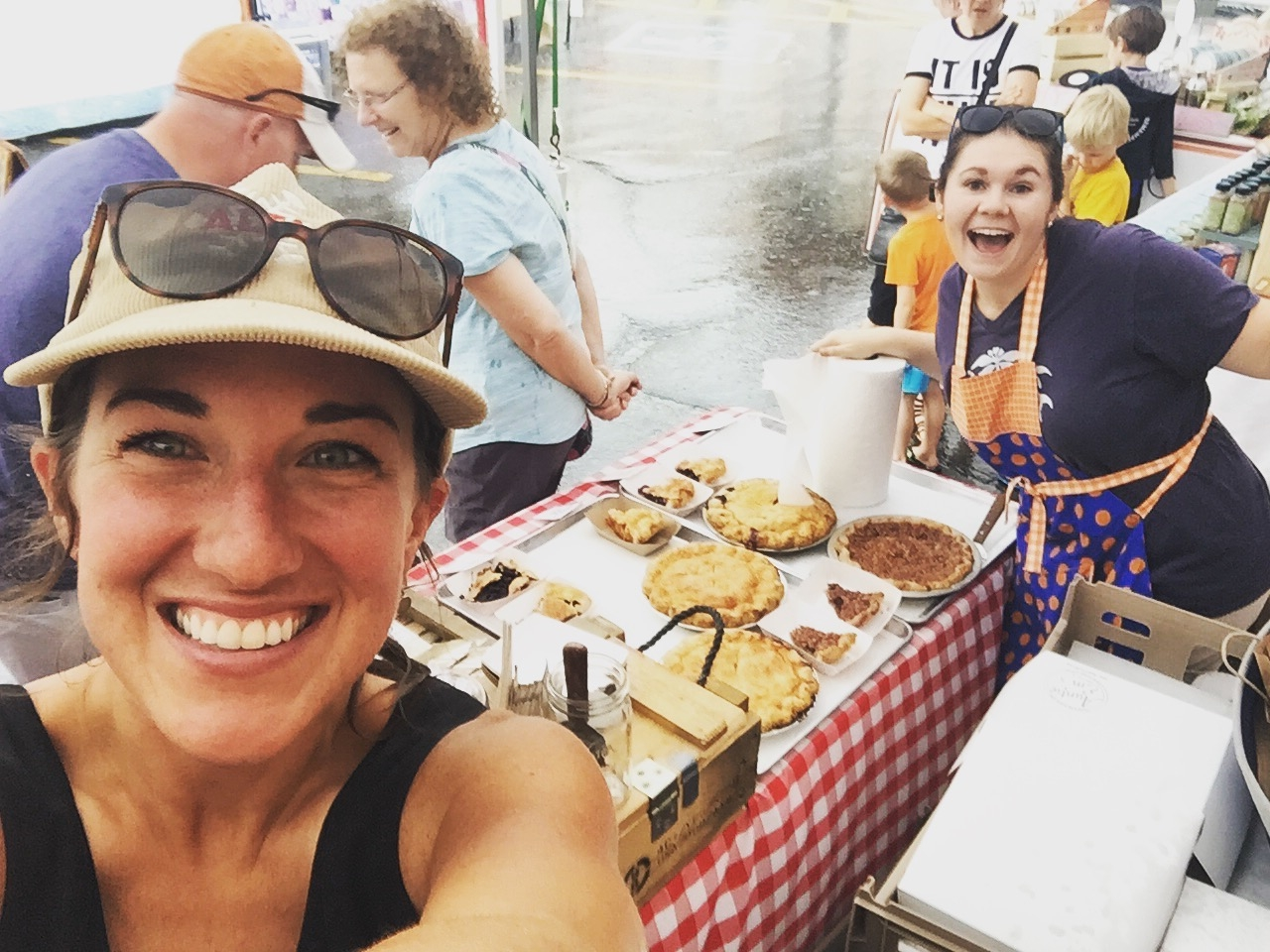 Emily and Rachel weathering the storm at a particularly rainy Park Silly Market in the summer of 2017.