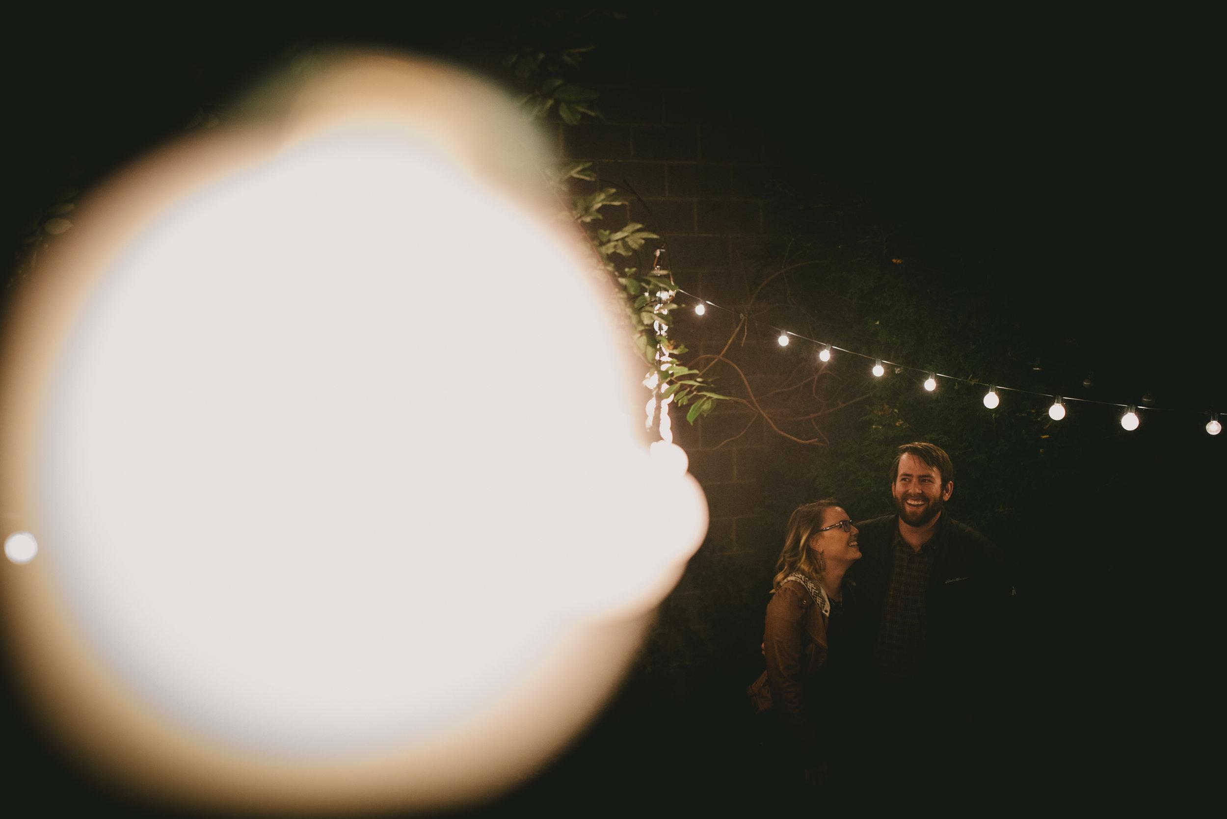 enchanted garden tea lights above the couple in Greensboro, North Carolina