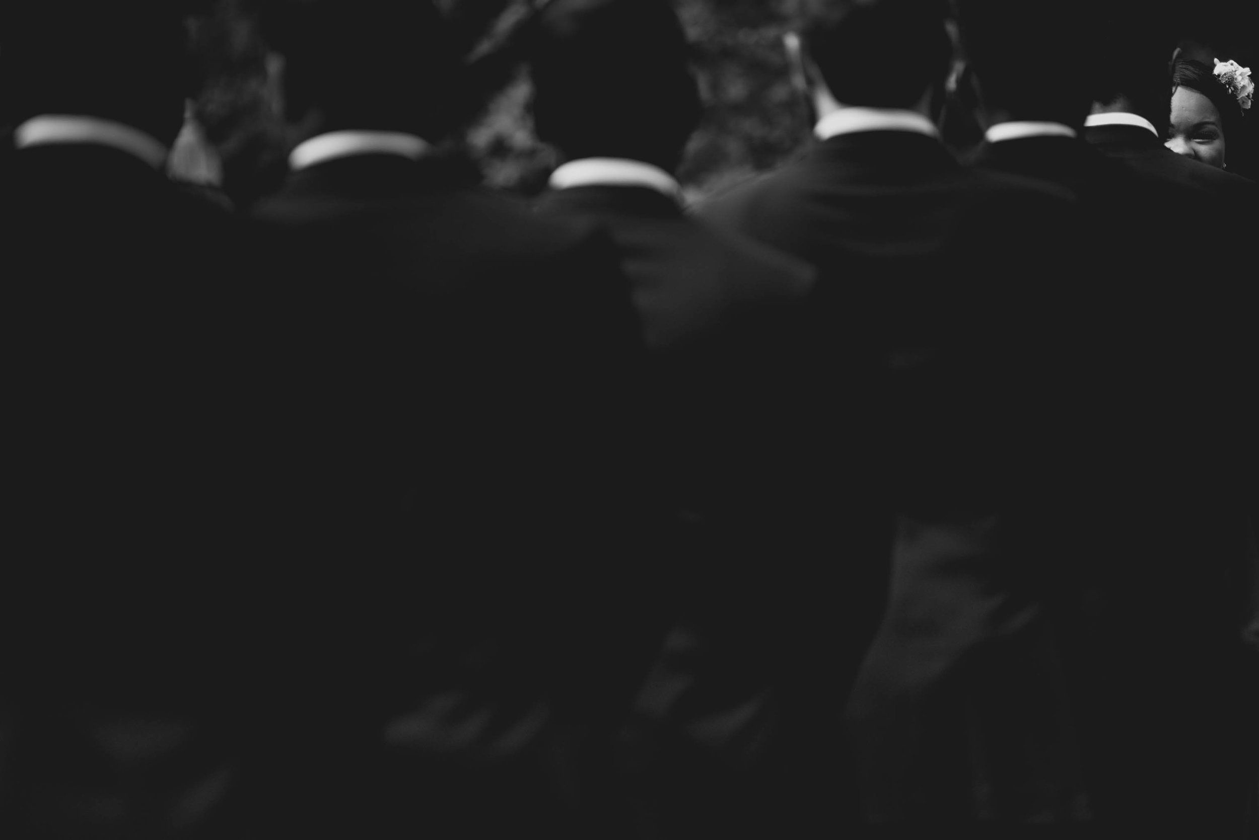 The groomsmen all lined up with the bride at the end during this beautiful wedding ceremony