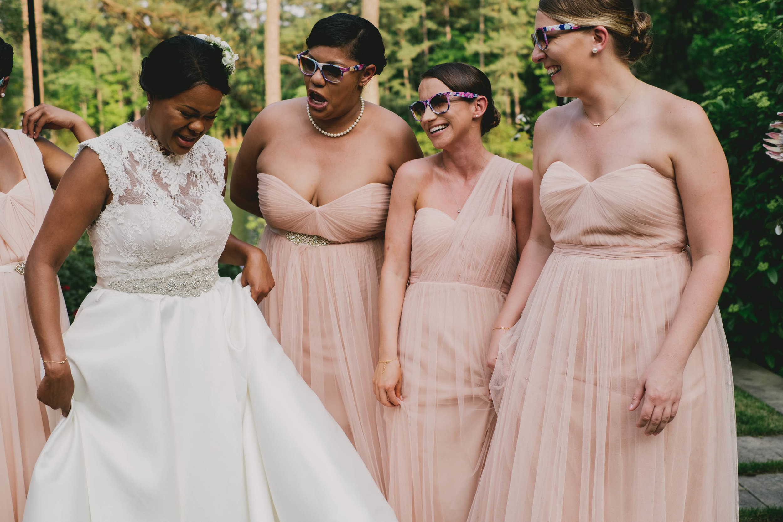 The bride trying not to laugh during photos after their ceremony