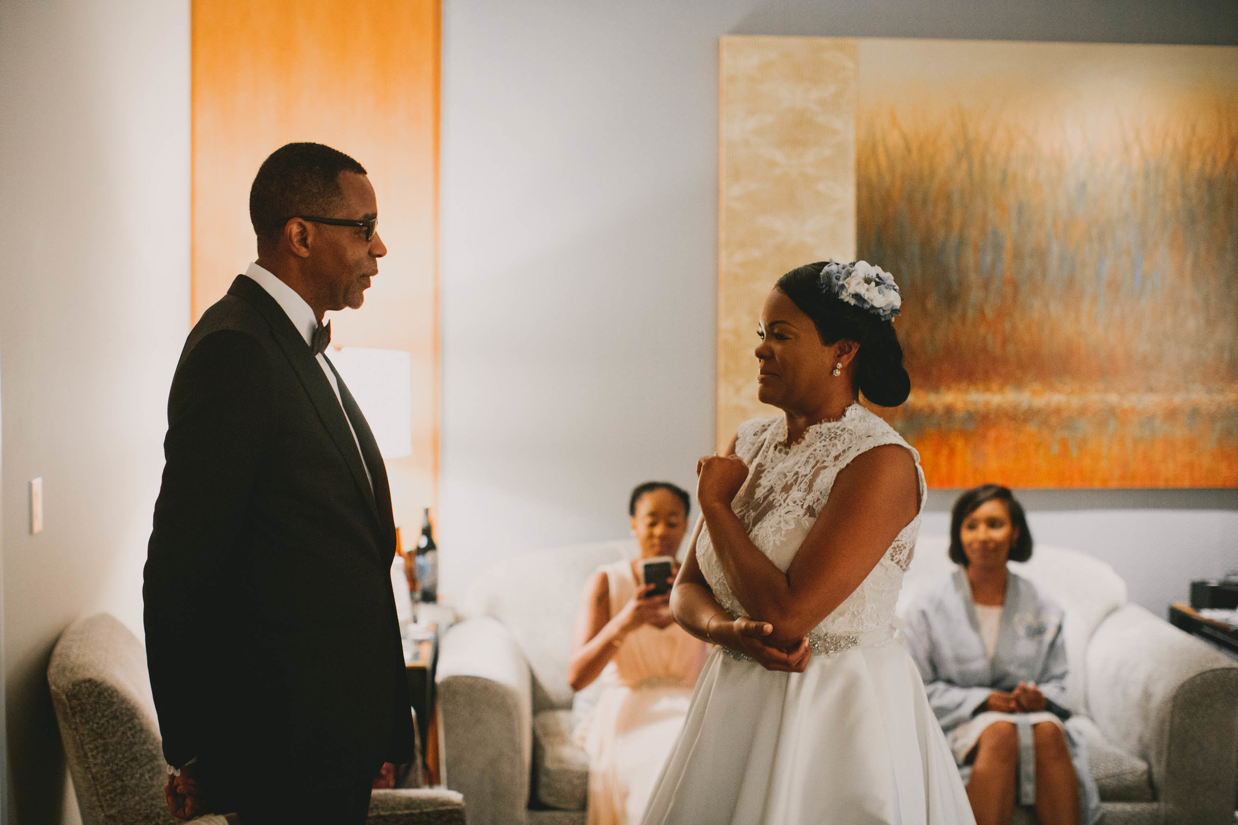 Bride checking that her dad is ready before the processional of their Umstead Hotel and Spa wedding
