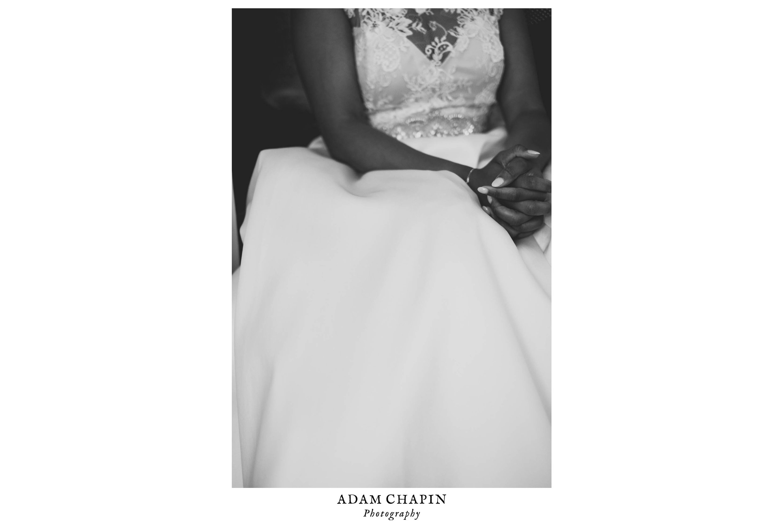 Bride sitting in her Monique Lhuillier dress before the ceremony at the Umstead Hotel and Spa