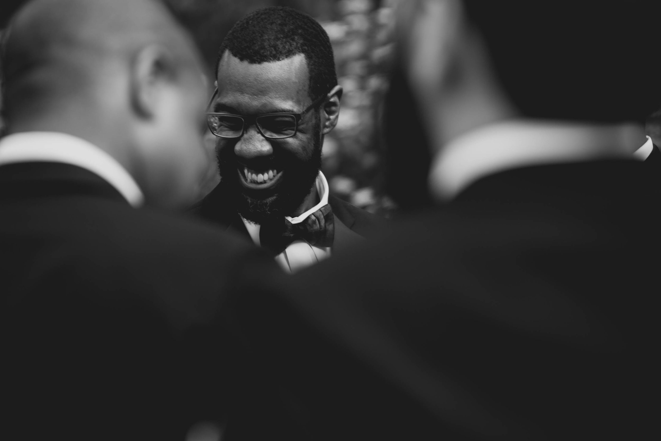 The groom and groomsmen sharing a laugh after the ceremony