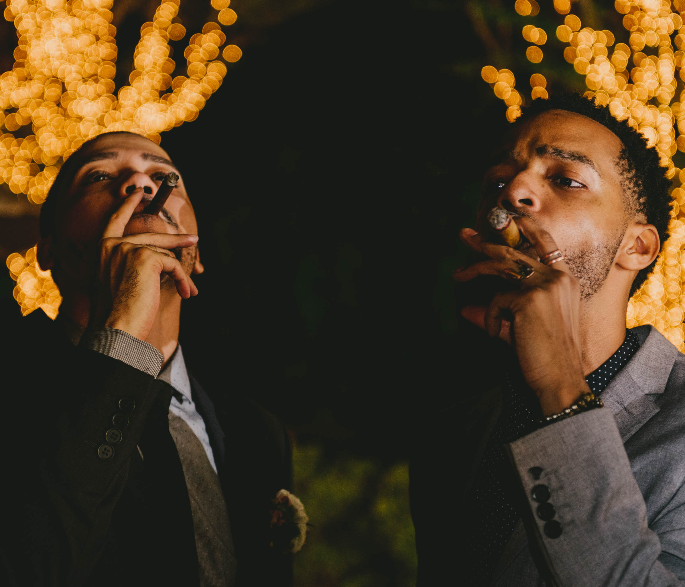 Two guests enjoy custom rolled cigars at this Umstead Hotel wedding