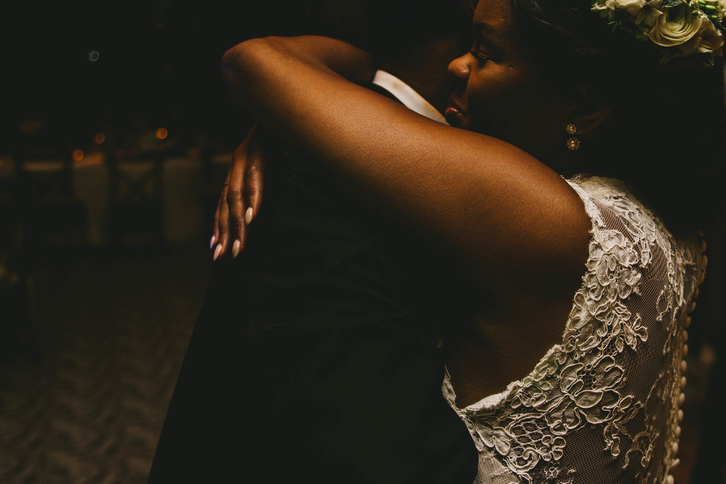 The bride and groom share a hug during their elegant Raleigh wedding