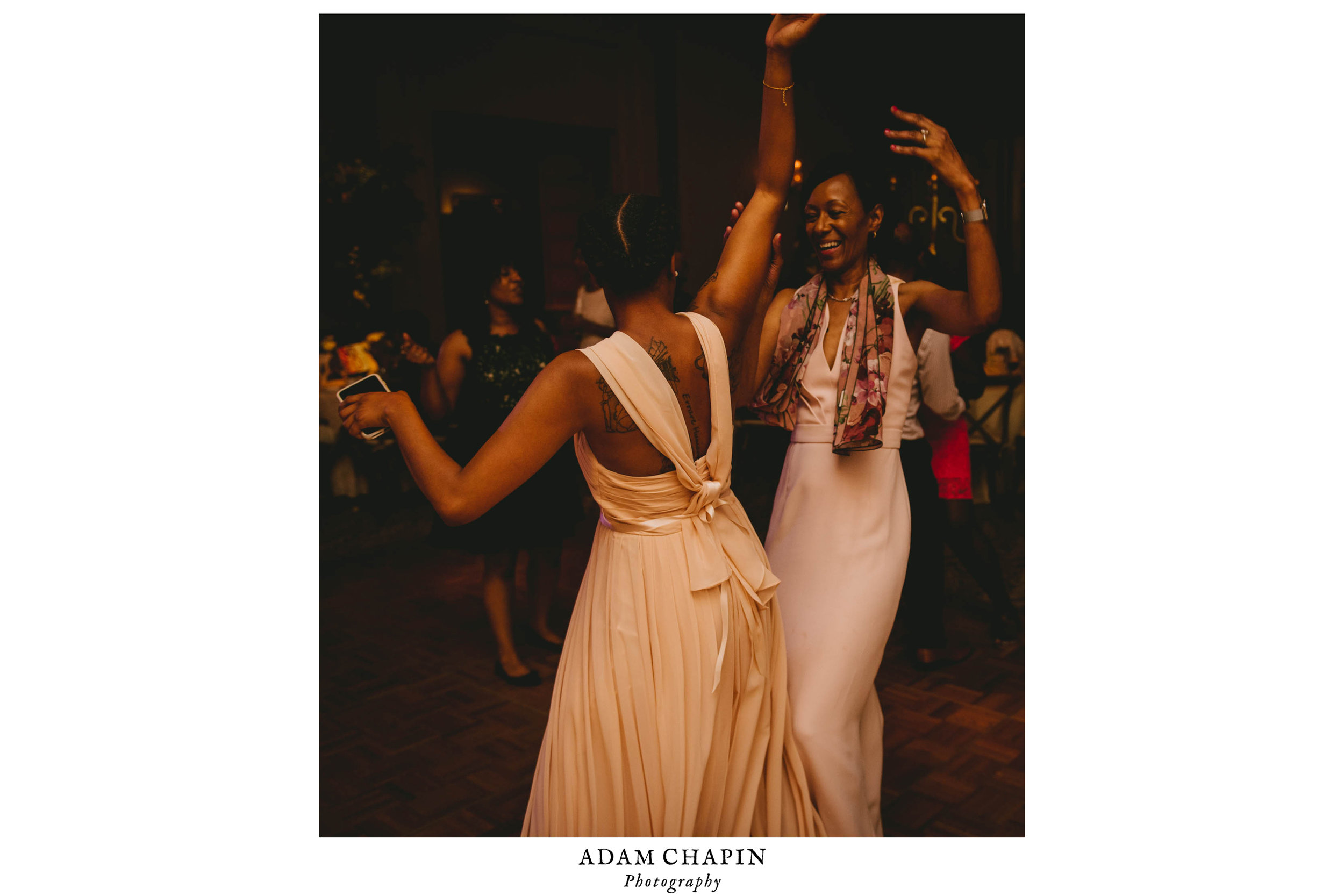 The brides sister and mother dancing during this Raleigh wedding