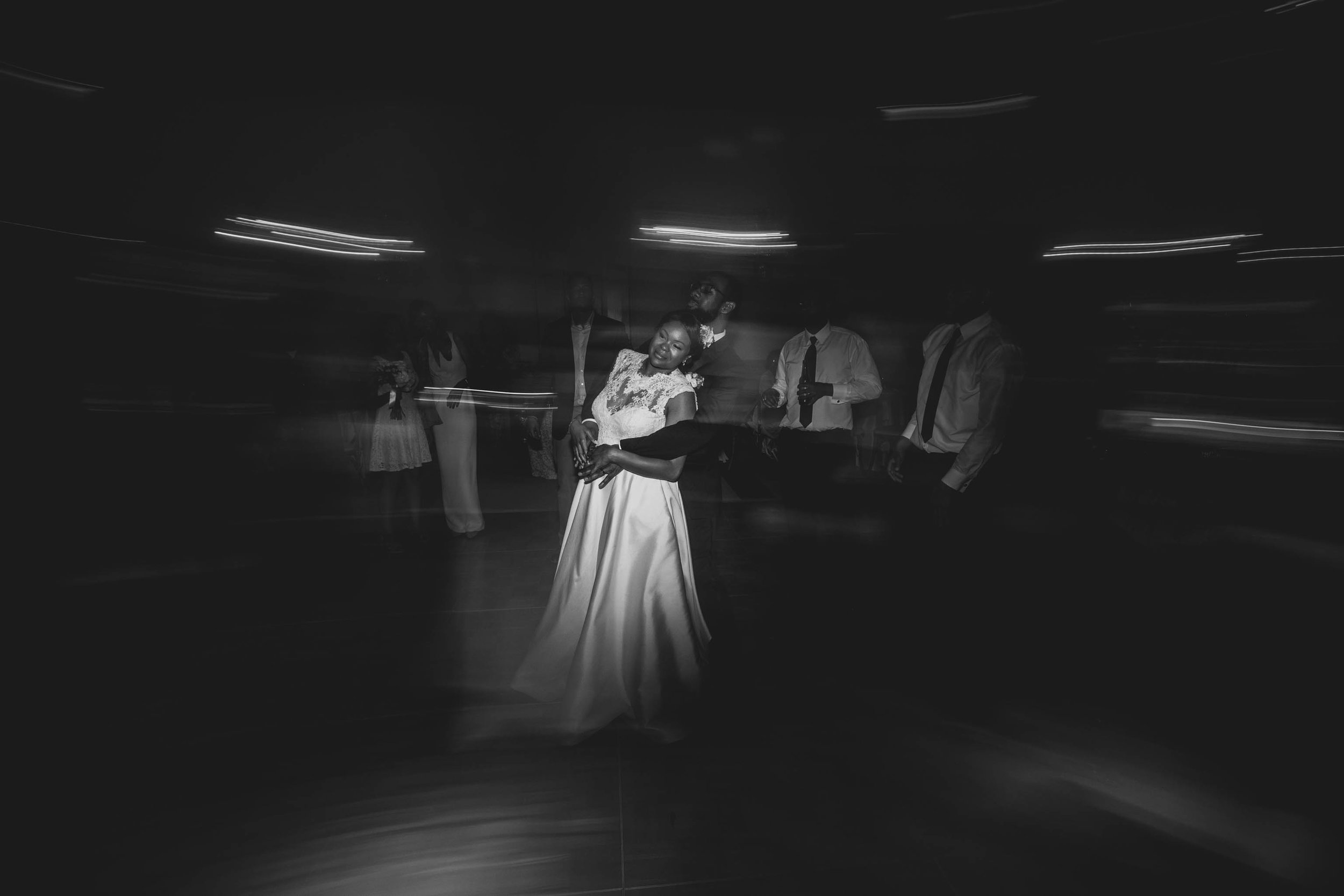 The bride and groom holding onto one another during the reception of this Raleigh wedding