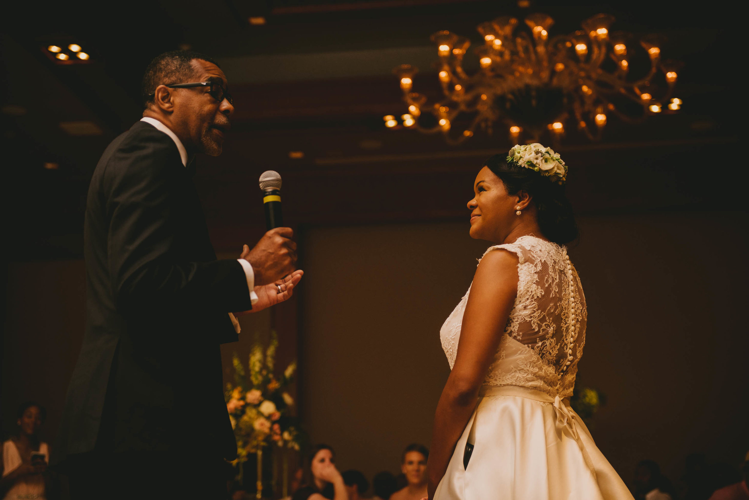 The father of the bride and the bride as her father gives an opening speech before dinner at the Umstead Hotel and Spa