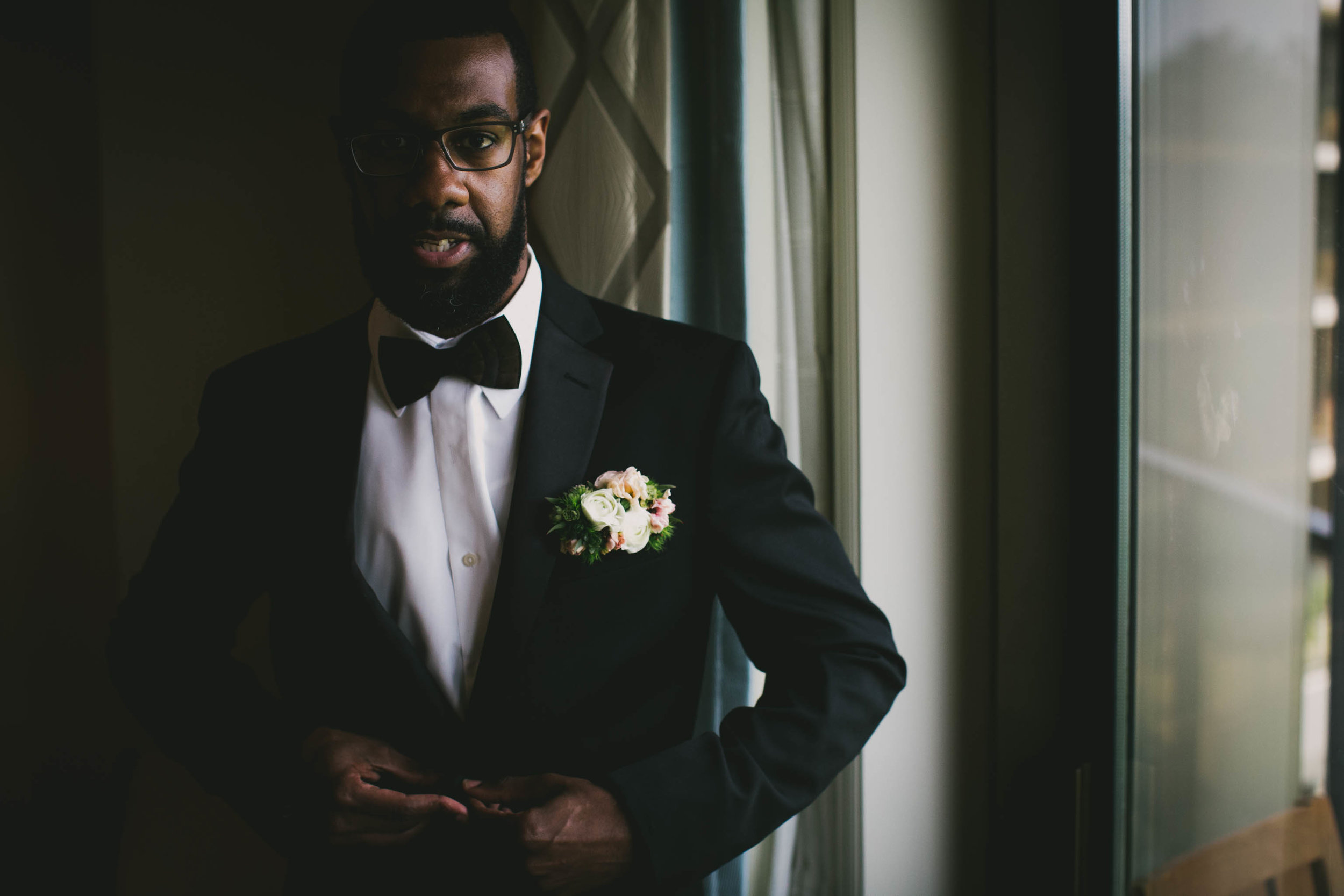 Groom getting ready for his Umstead Hotel and Spa wedding