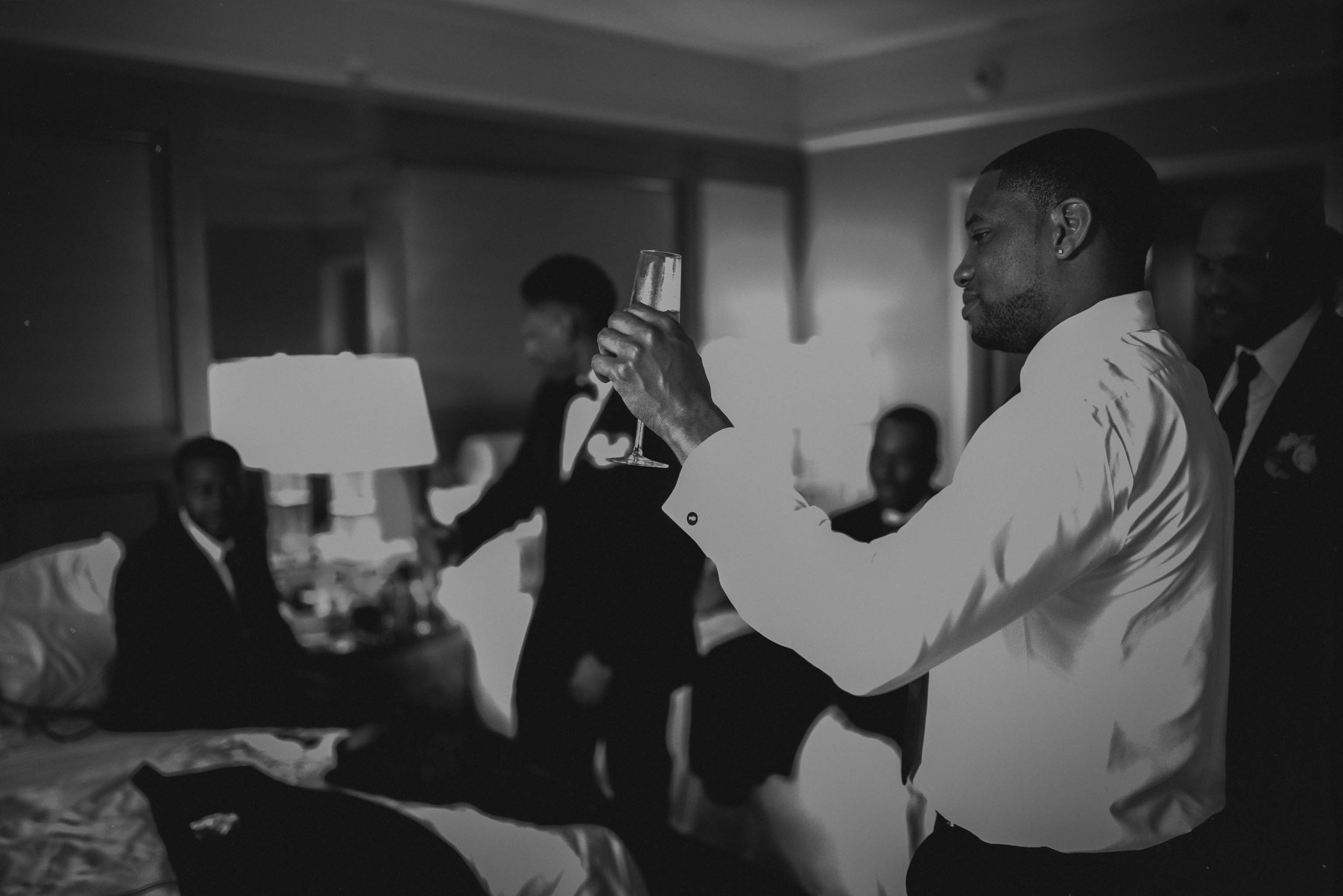 Groomsmen toasting to the Groom before the wedding at the Umstead Hotel