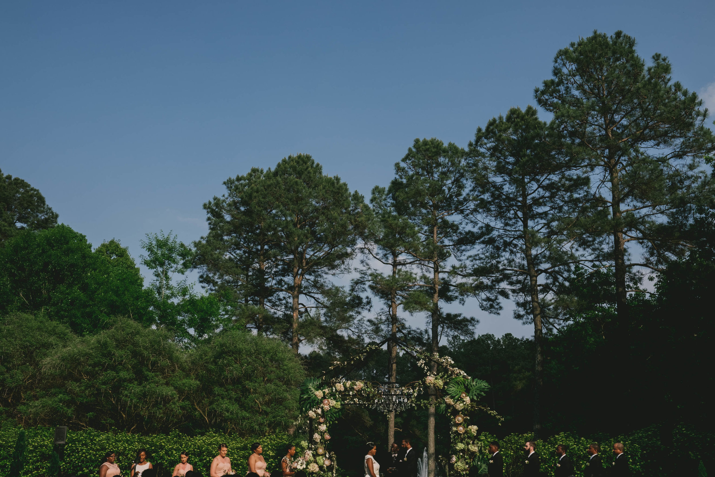 The wedding party preparing for the recessional at this Umstead Hotel wedding
