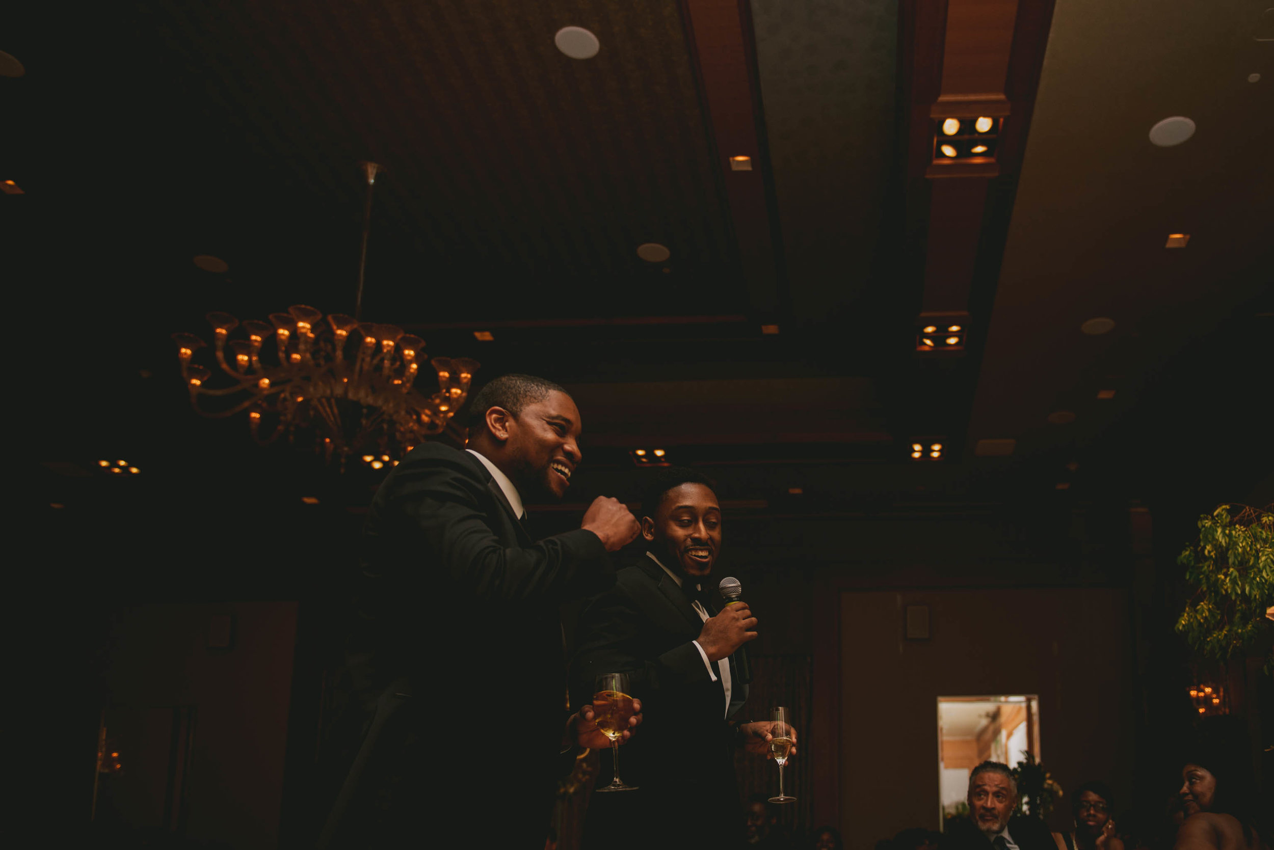 The best men sharing some wise words and a toast at this Raleigh wedding