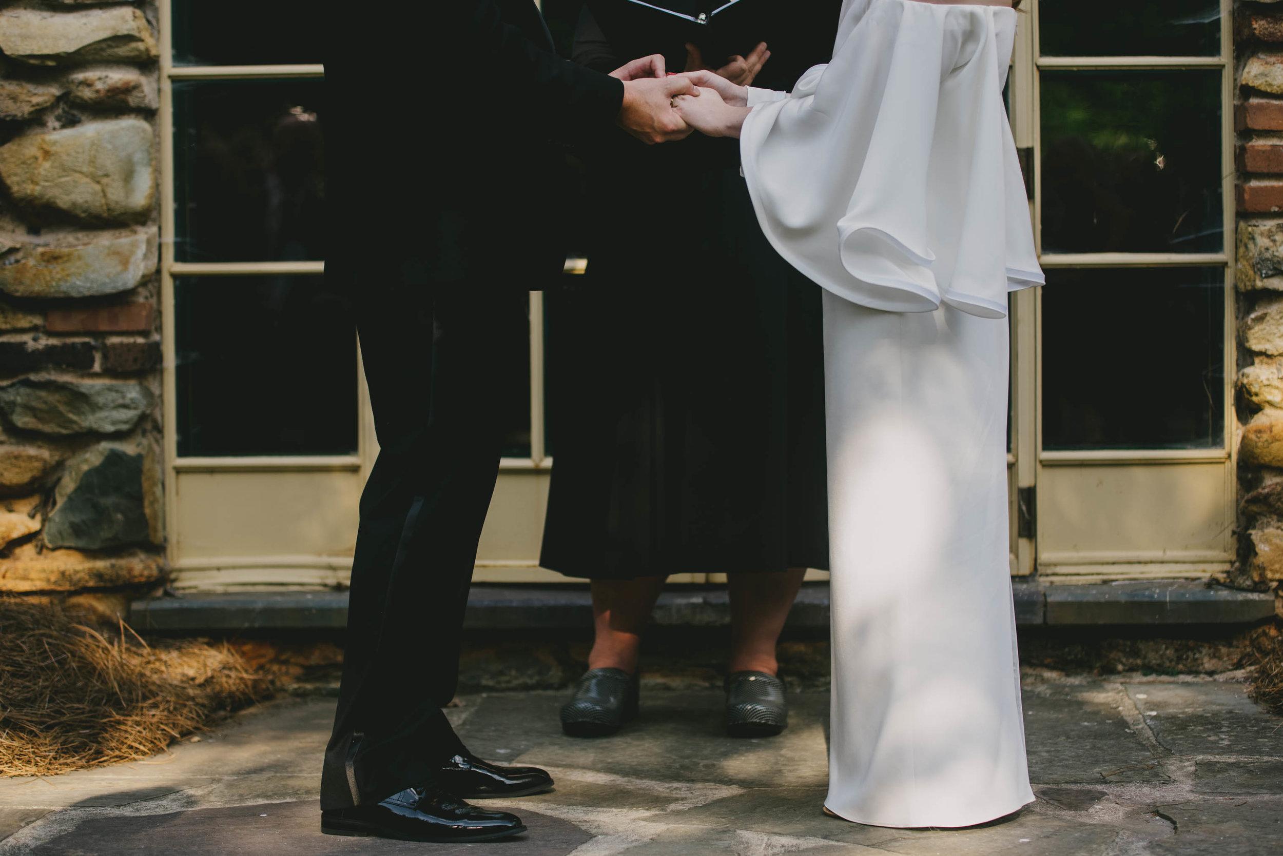 houghton-bride-and-her-groom-photo-exchanging-rings.jpg