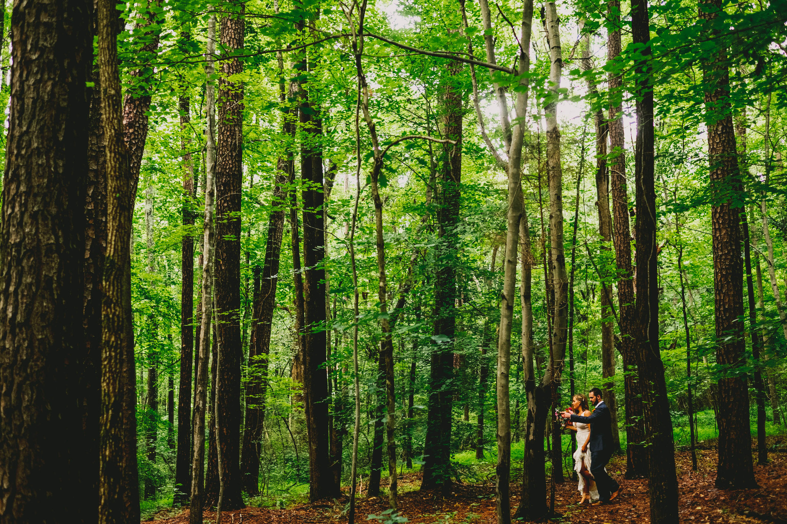 mims-house-wedding-bride-and-groom-off-into-the-woods.jpg