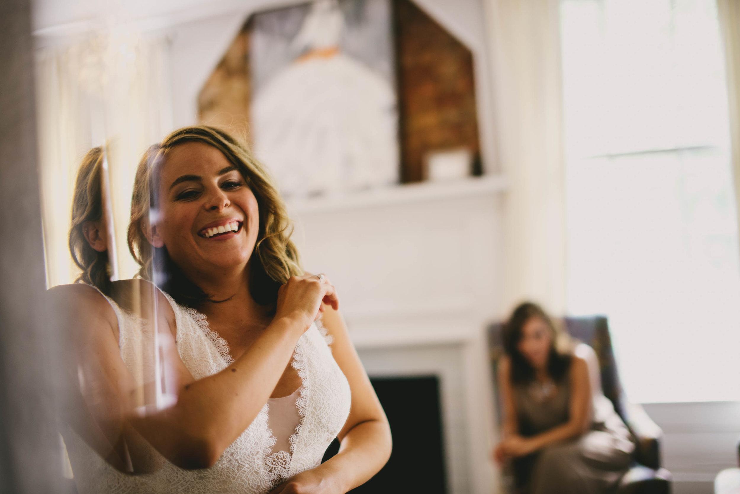mims-house-wedding-bride-getting-her-BHLDN-dress-on.jpg