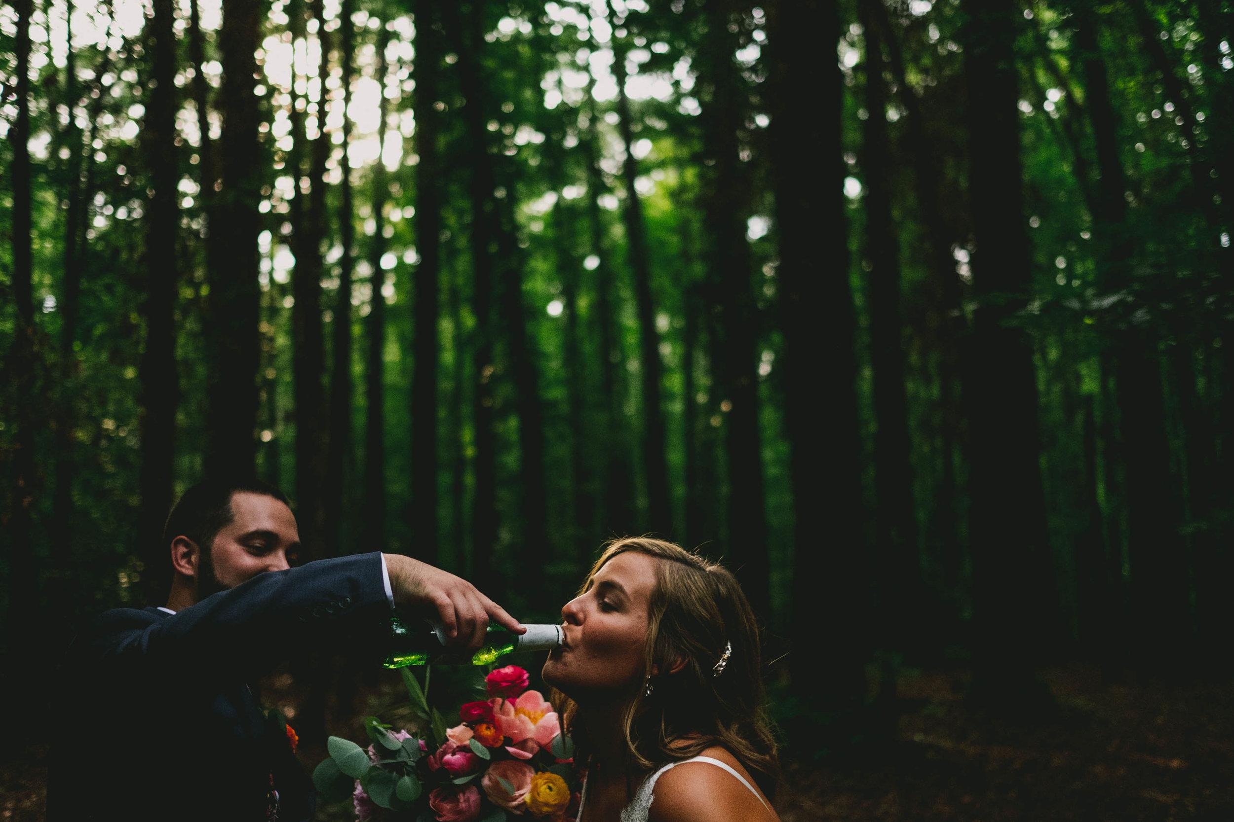 mims-house-wedding-groom-helping-bride-with-beer.jpg