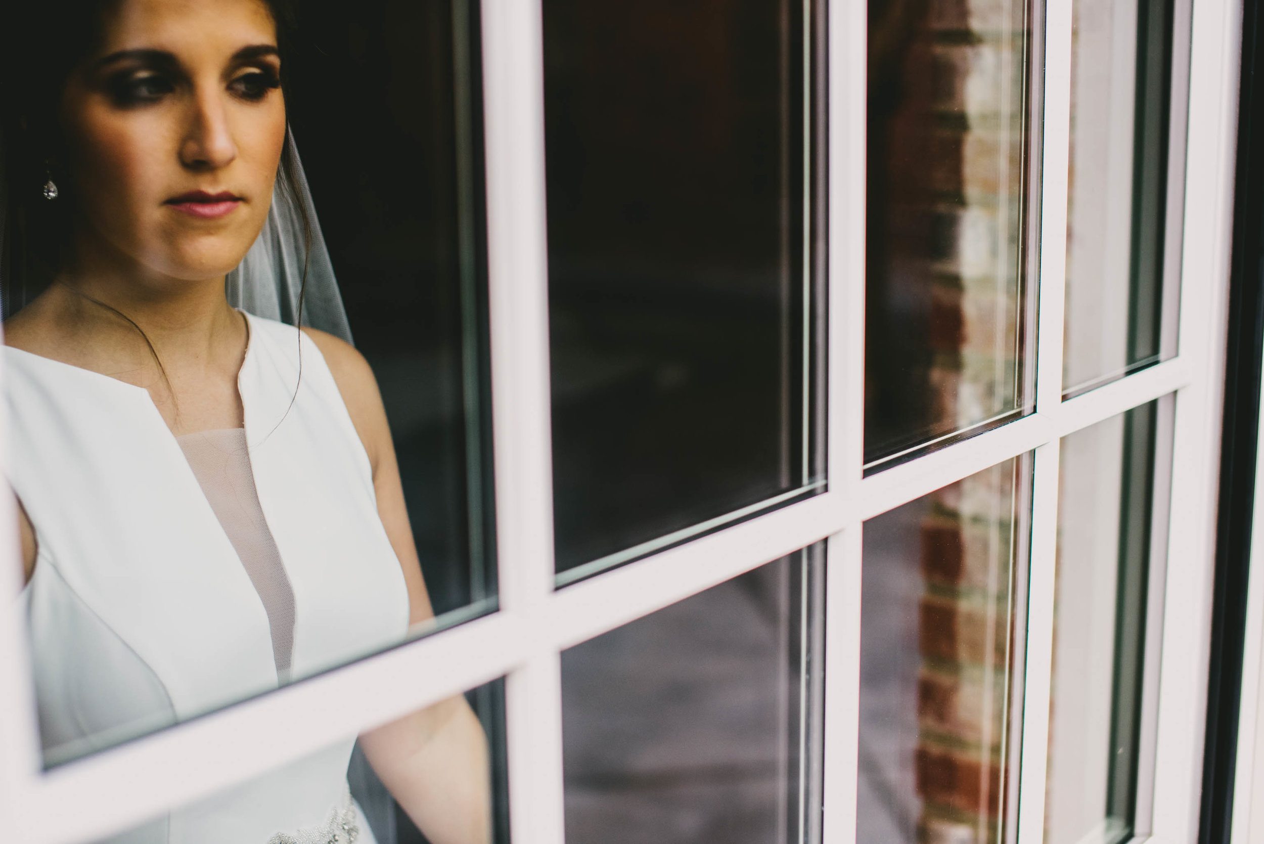bride-looking-out-window-at-the-clothmill-photo.jpg