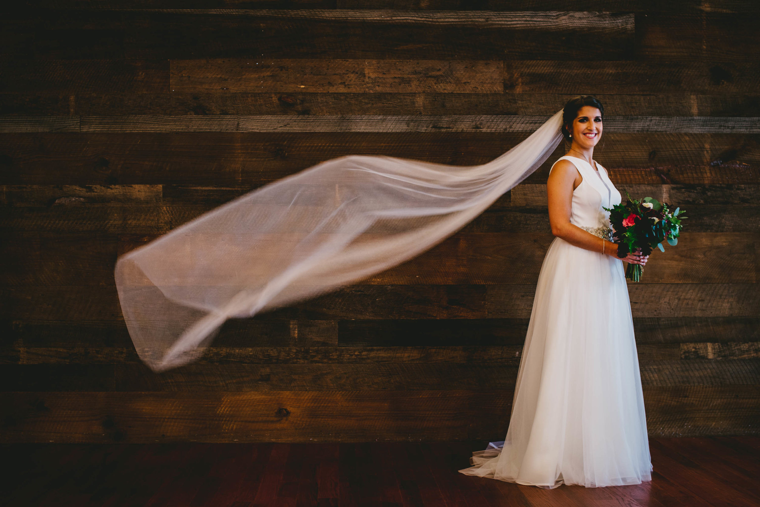 brides-flowing-veil-and-eugenia-couture-dress-photo.jpg