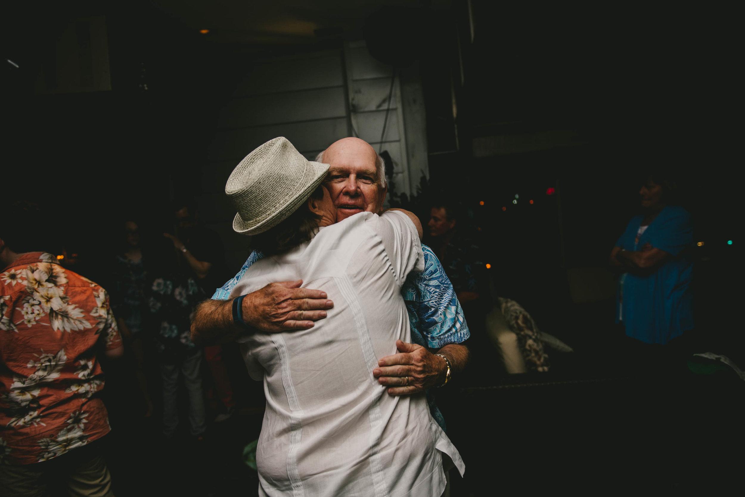 solas-restaurant-raleigh-same-sex-wedding-bride-hugging-dad-photo.jpg