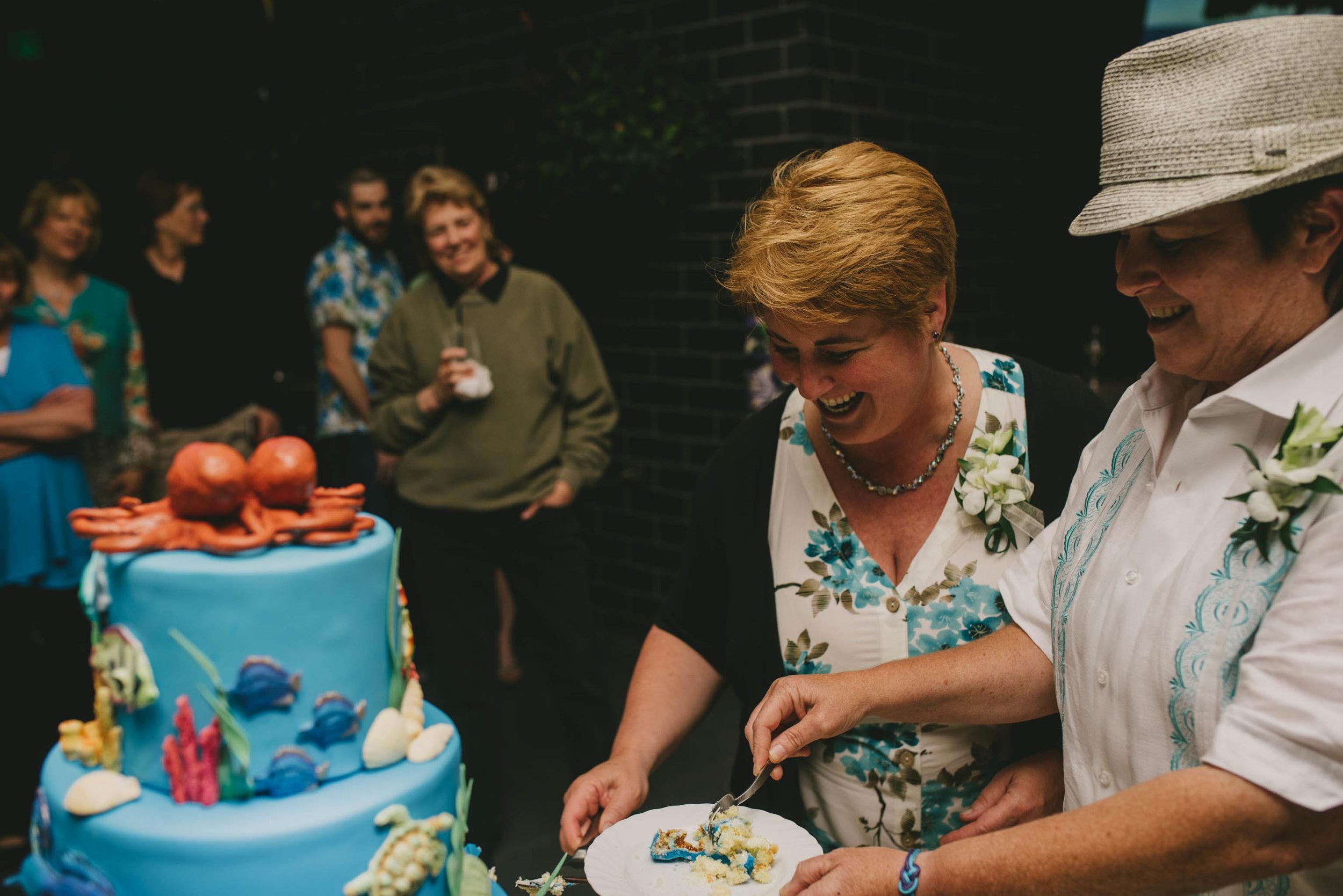 solas-restaurant-raleigh-same-sex-wedding-cake-cutting-photo.jpg