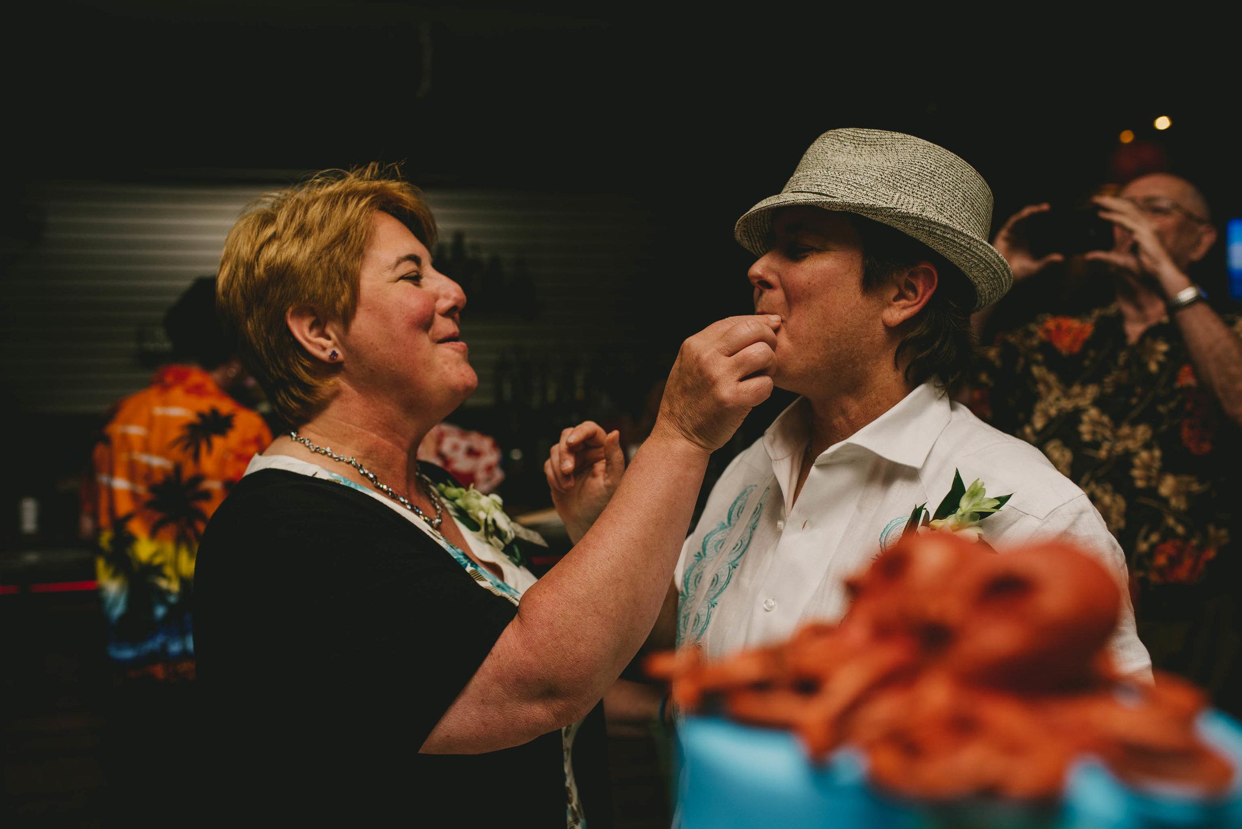 solas-restaurant-raleigh-same-sex-wedding-cake-cutting-photos.jpg