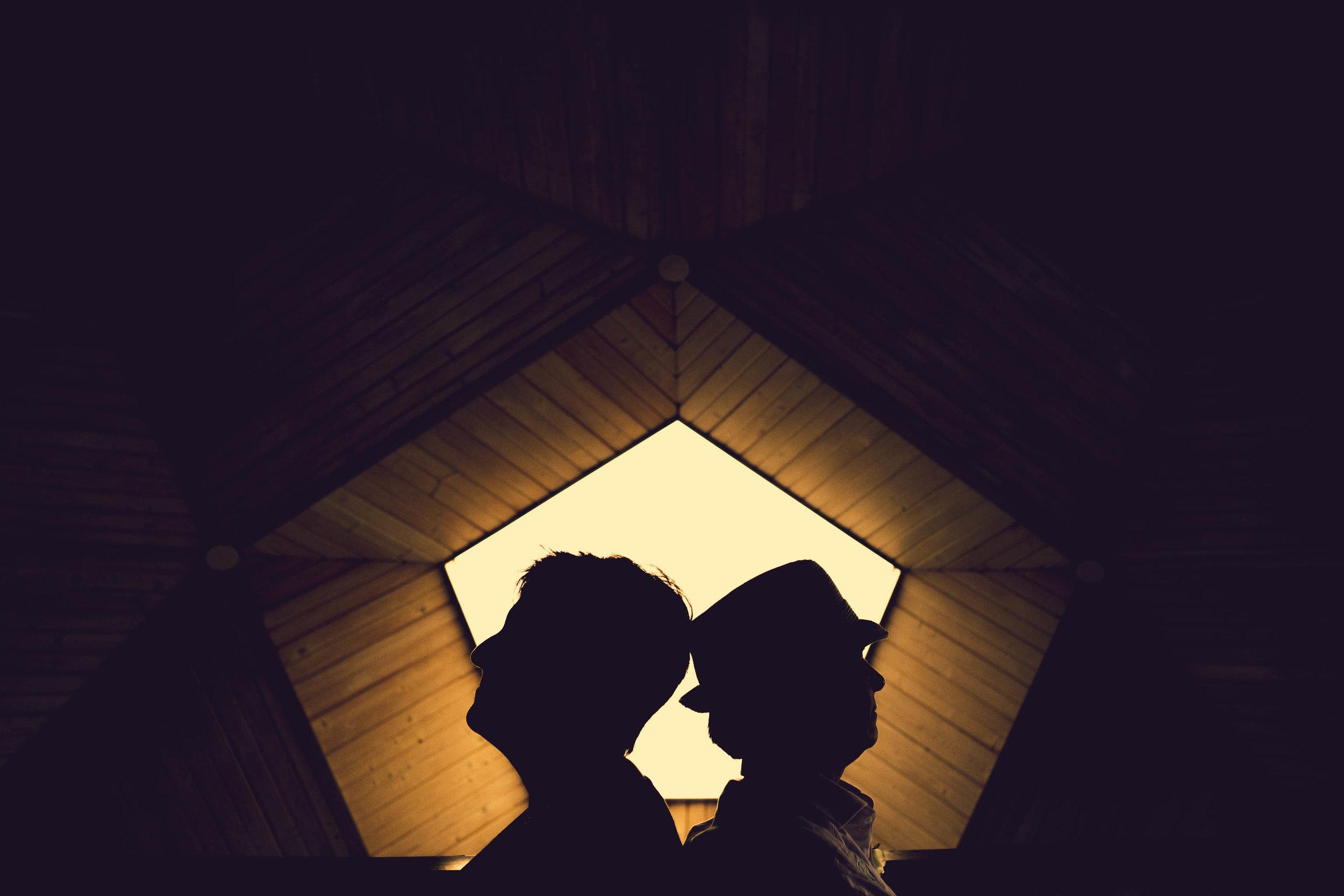 topsail-island-same-sex-beach-wedding-creative-couples-portrait.jpg